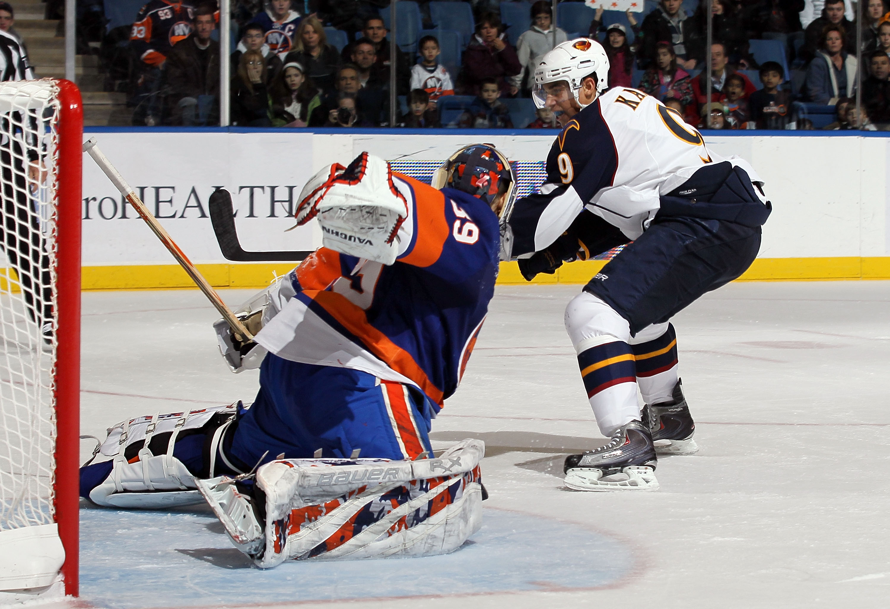 UNIONDALE, NY - DECEMBER 11:  Rick DiPietro #39 of the New York Islanders makes a penalty shot save against Evander Kane #9 of the Atlanta Thrashers during the third period on December 11, 2010 at Nassau Coliseum in Uniondale, New York. The Thrashers defe