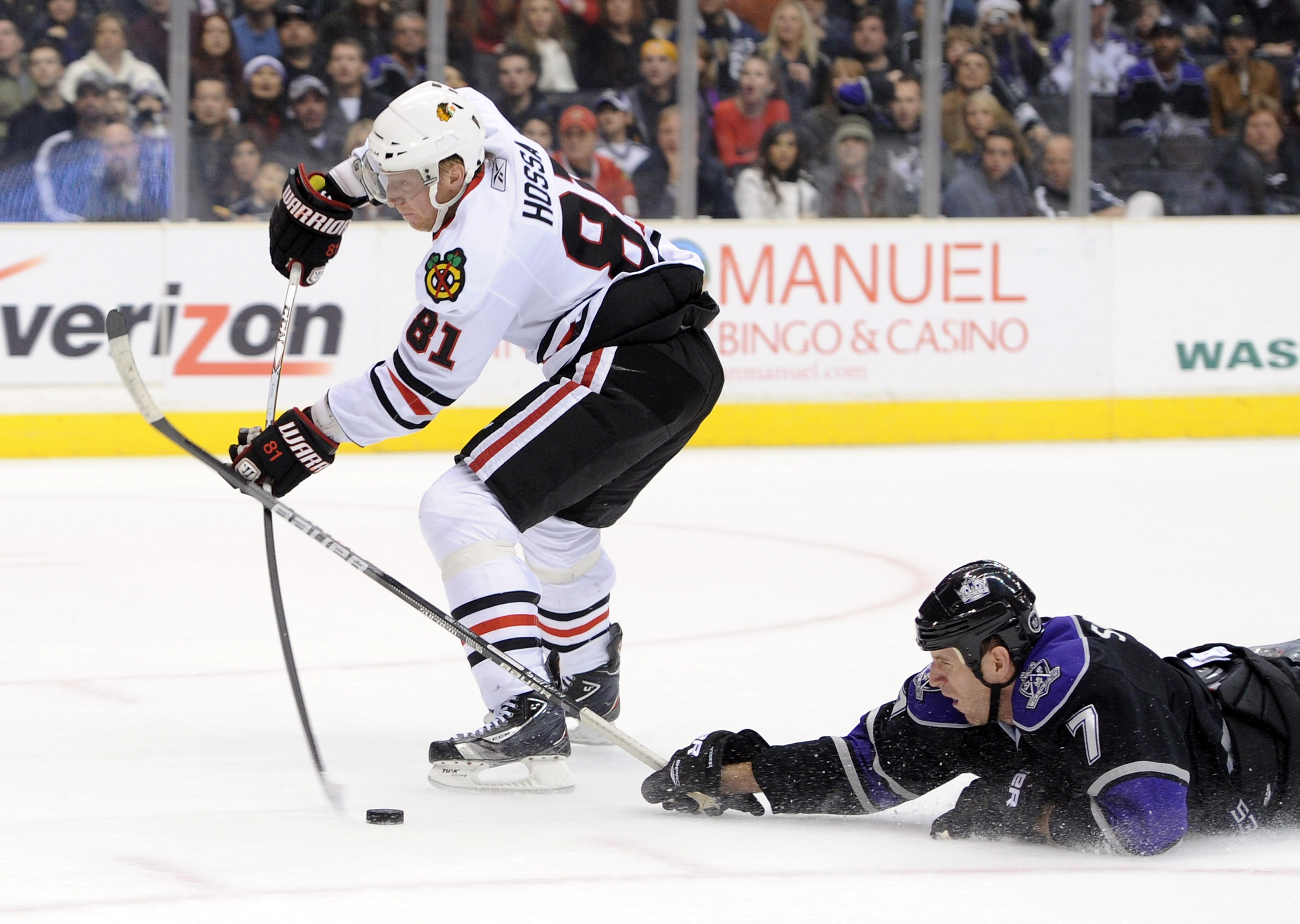 LOS ANGELES, CA - NOVEMBER 27:  Marian Hossa #81 of the Chicago Blackhawks has the puck knocked away on his breakaway by a diving Rob Scuderi #7 of the Los Angeles Kings during the first period at Staples Center on November 27, 2010 in Los Angeles, Califo