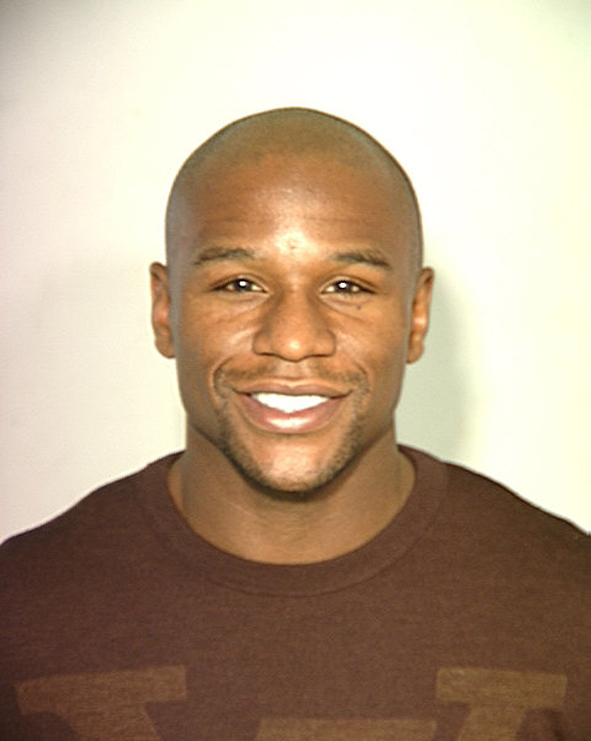 LAS VEGAS, NV - UNDATED: In this handout provided by the Las Vegas Police Department, boxer Floyd Mayweather Jr. poses for a mug shot in Las Vegas, Nevada. Mayweather was arrested for a misdemeanor battery warrant December 16, 2010 at a casino on the Las