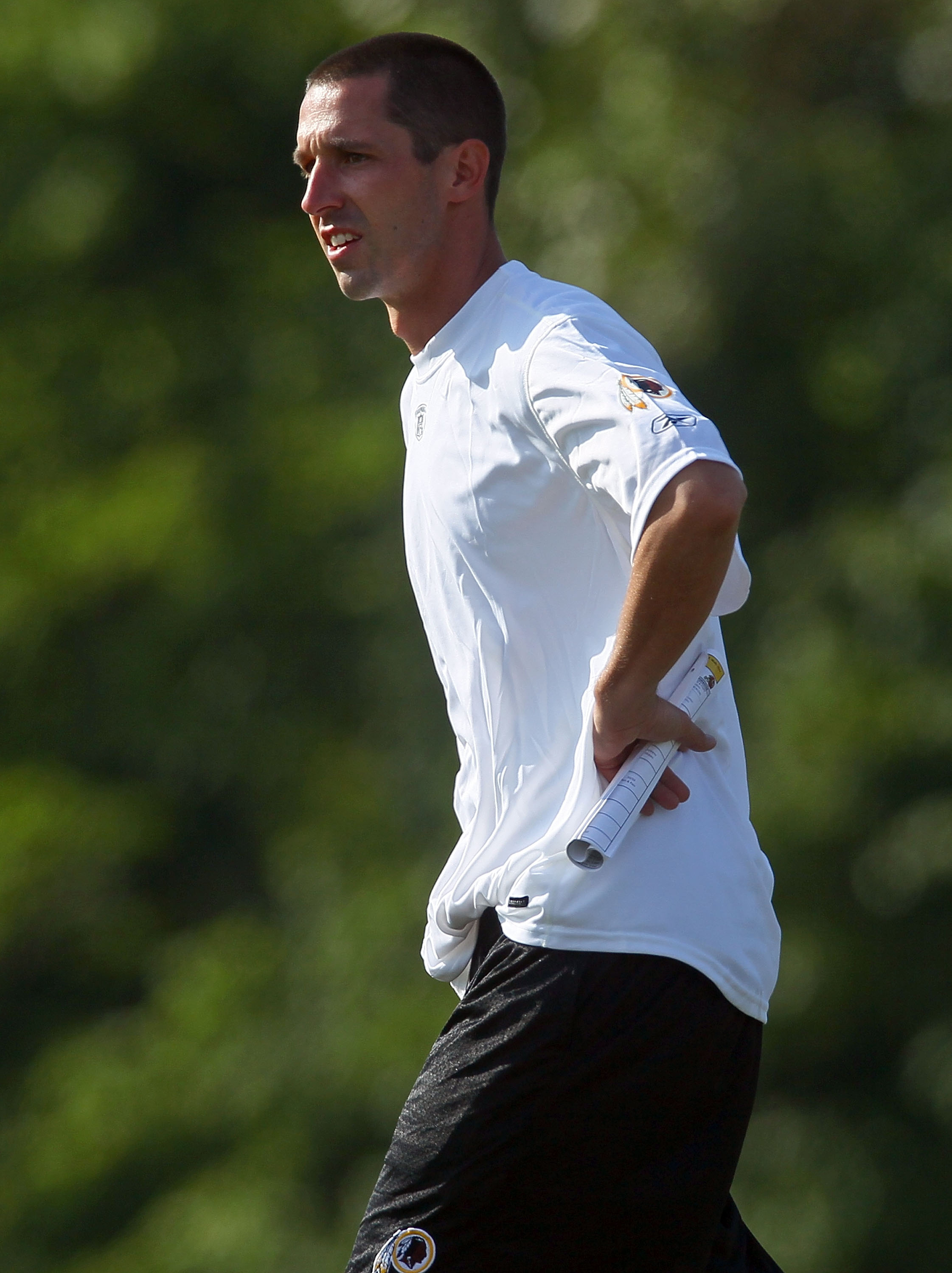ASHBURN, VA - JULY 30:  Offensive coordinator Kyle Shanahan of the Washington Redskins watches drills during the second day of training camp July 30, 2010 in Ashburn, Virginia.  (Photo by Win McNamee/Getty Images)
