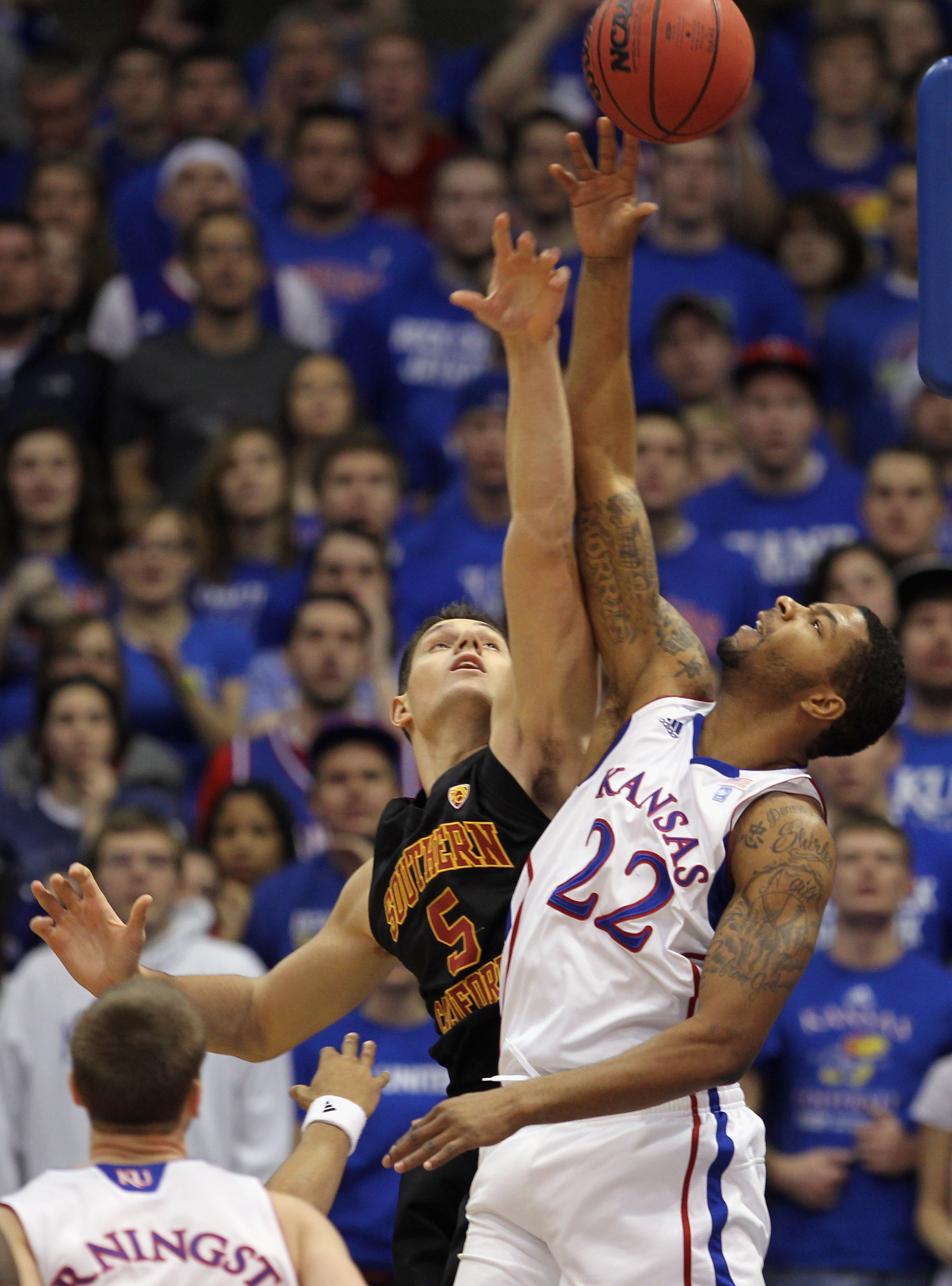 LAWRENCE, KS - DECEMBER 18:  Marcus Morris #22 of the Kansas Jayhawks battles Nikola Vucevic #5 of the USC Trojans for a rebound during the game on December 18, 2010 at Allen Fieldhouse in Lawrence, Kansas.  (Photo by Jamie Squire/Getty Images)