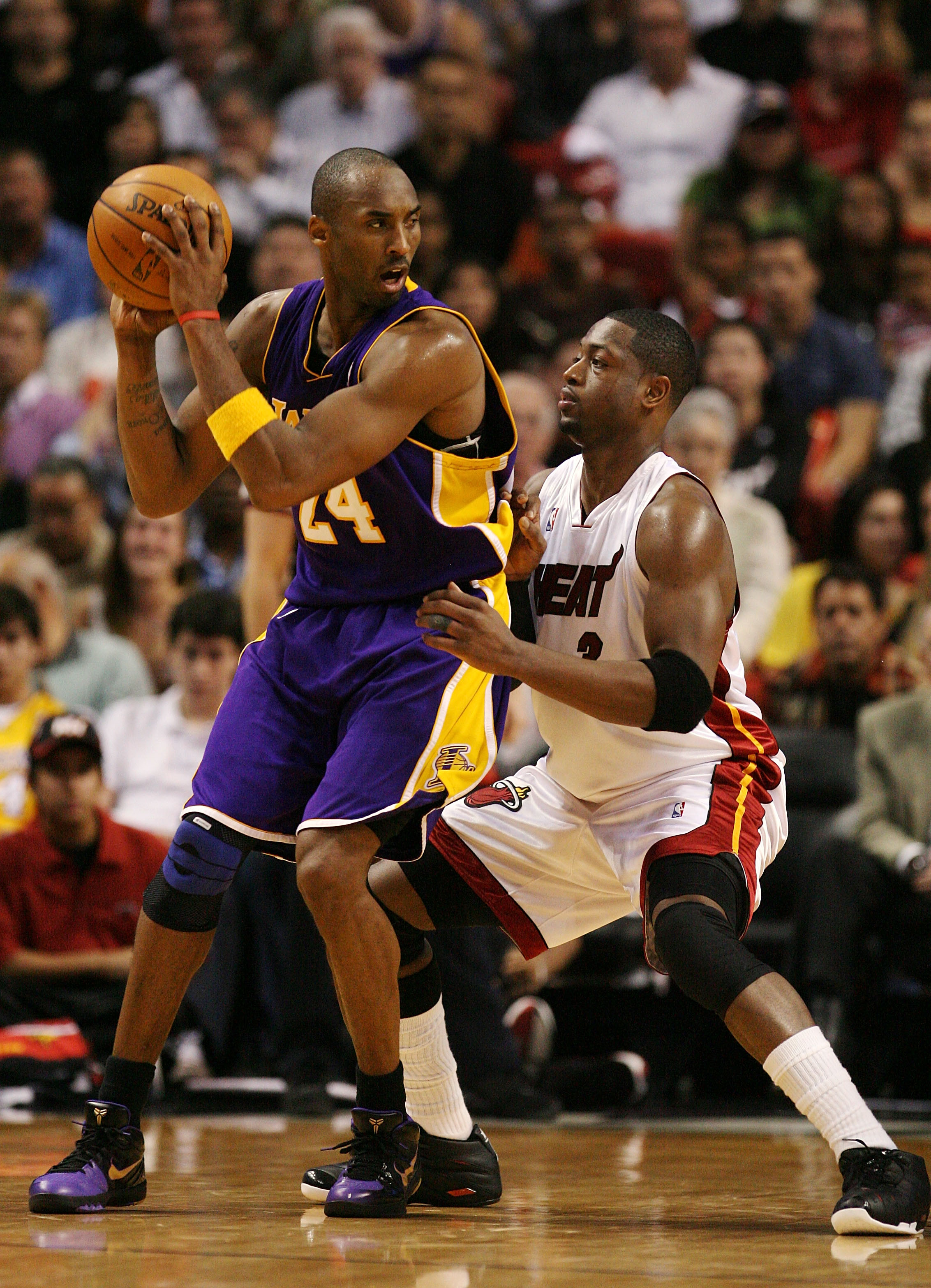 MIAMI - DECEMBER 19:  Dwyane Wade #3 of the Miami Heat guards Kobe Bryant #24 of the Los Angeles Lakers at American Airlines Arena on December 19, 2008 in Miami, Florida. The Heat defeated the Lakers 89-87. NOTE TO USER: User expressly acknowledges and ag