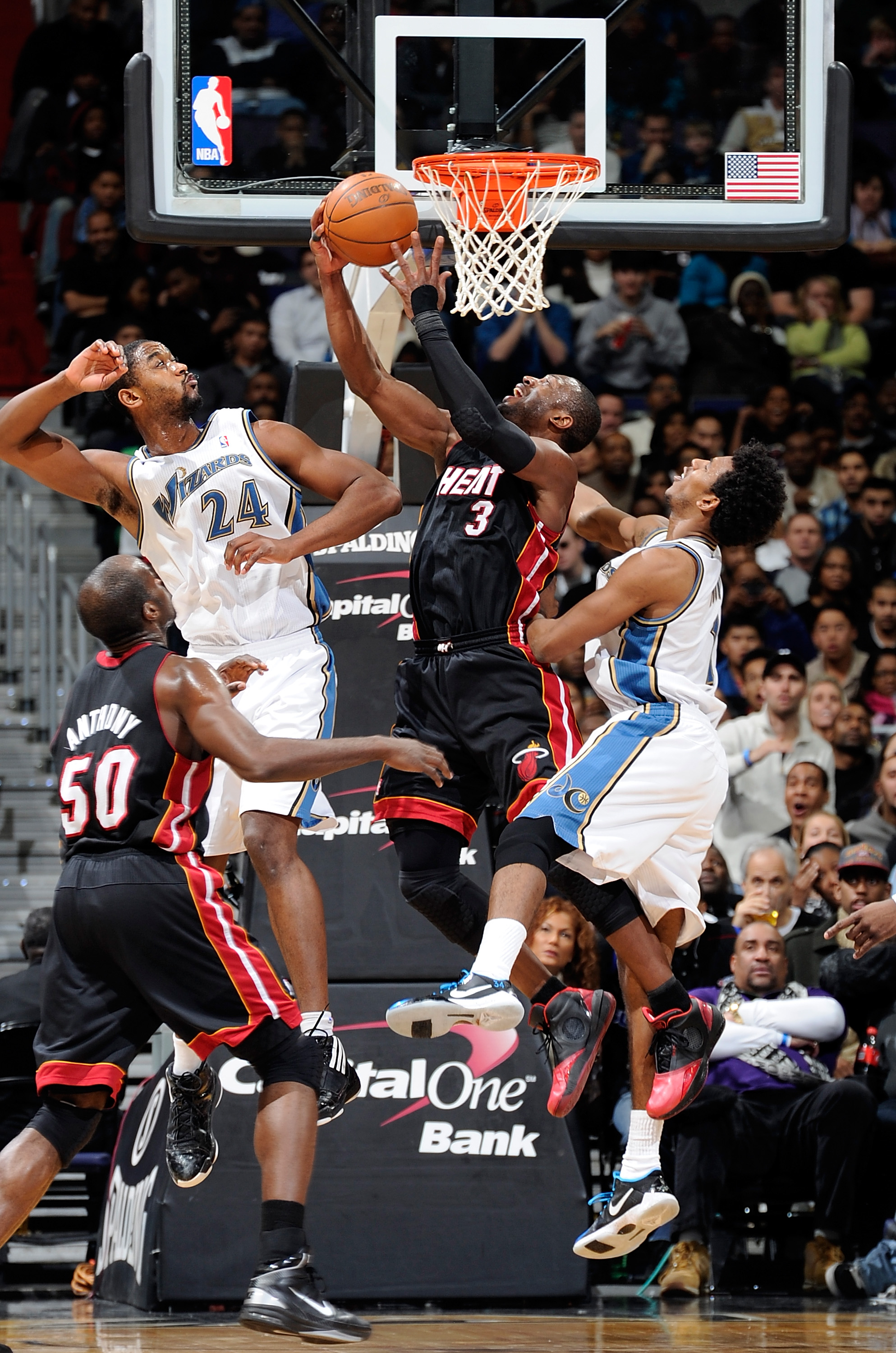 WASHINGTON - DECEMBER 18:  Dwyane Wade #3 of the Miami Heat drives to the hoop against Hilton Armstron #24 and Nick Young #1 of the Washington Wizards at the Verizon Center on December 18, 2010 in Washington, DC.  NOTE TO USER: User expressly acknowledges