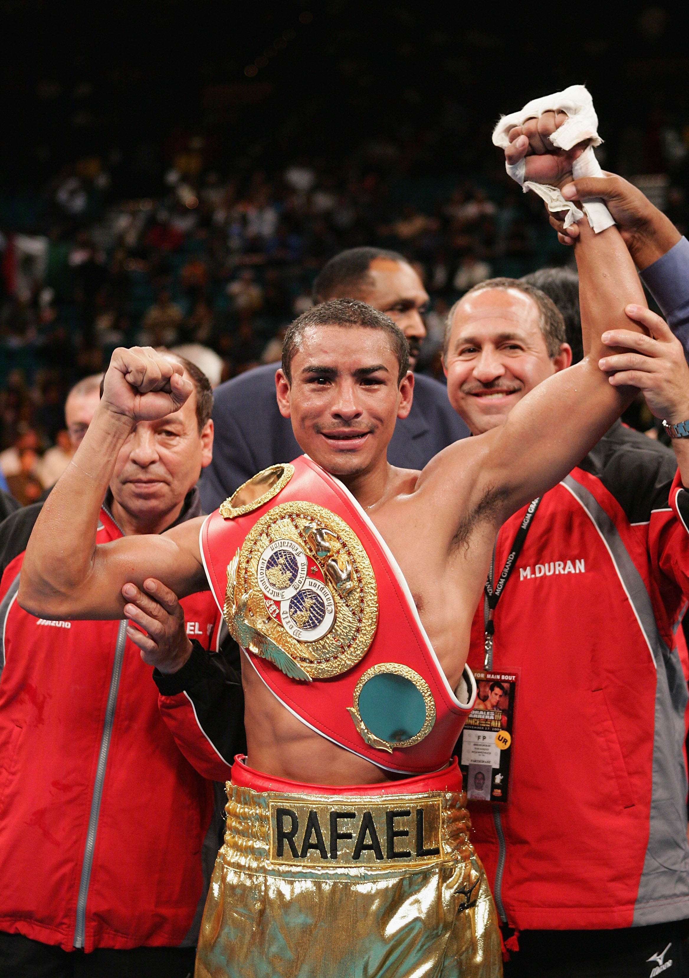 LAS VEGAS - NOVEMBER 27:  Rafael Marquez celebrates after defeating Mauricio Pastrana for the IBF World Bantamweight Championship at the MGM Grand Garden Arena on November 27, 2004 in Las Vegas, Nevada. Marquez defeated Pastrana by TKO after the 8th round