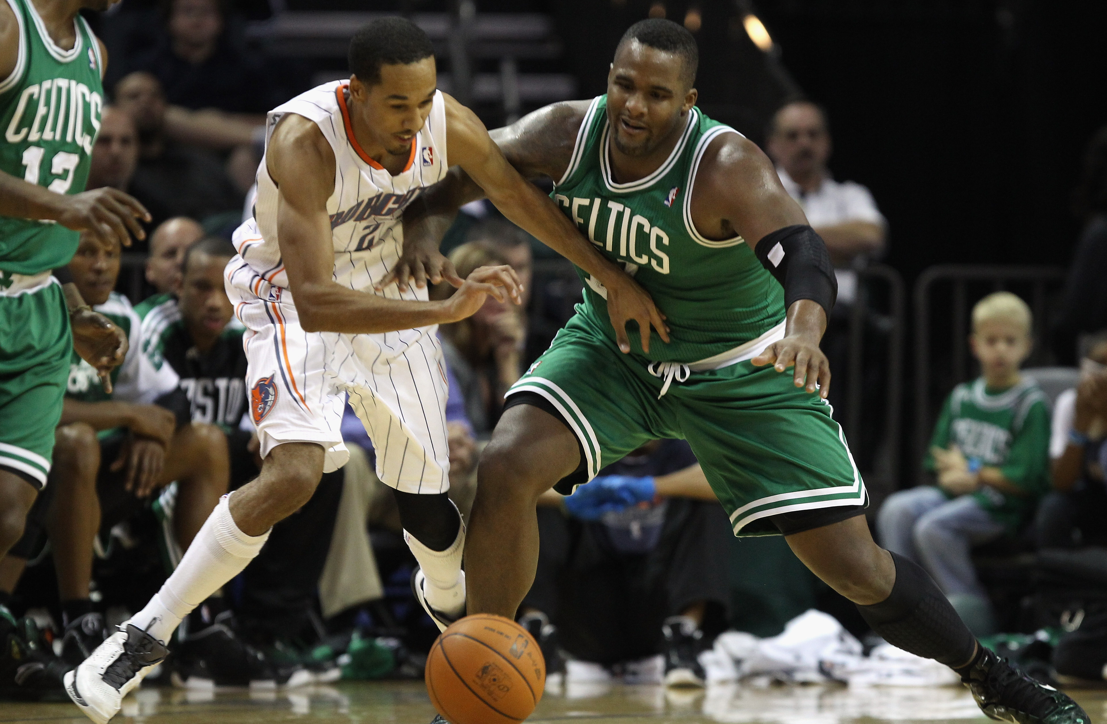 CHARLOTTE, NC - DECEMBER 11:  Glen Davis #11 of the Boston Celtics battles for a loose ball with Shaun Livingston #2 of the Charlotte Bobcats during their game at Time Warner Cable Arena on December 11, 2010 in Charlotte, North Carolina. NOTE TO USER: Use