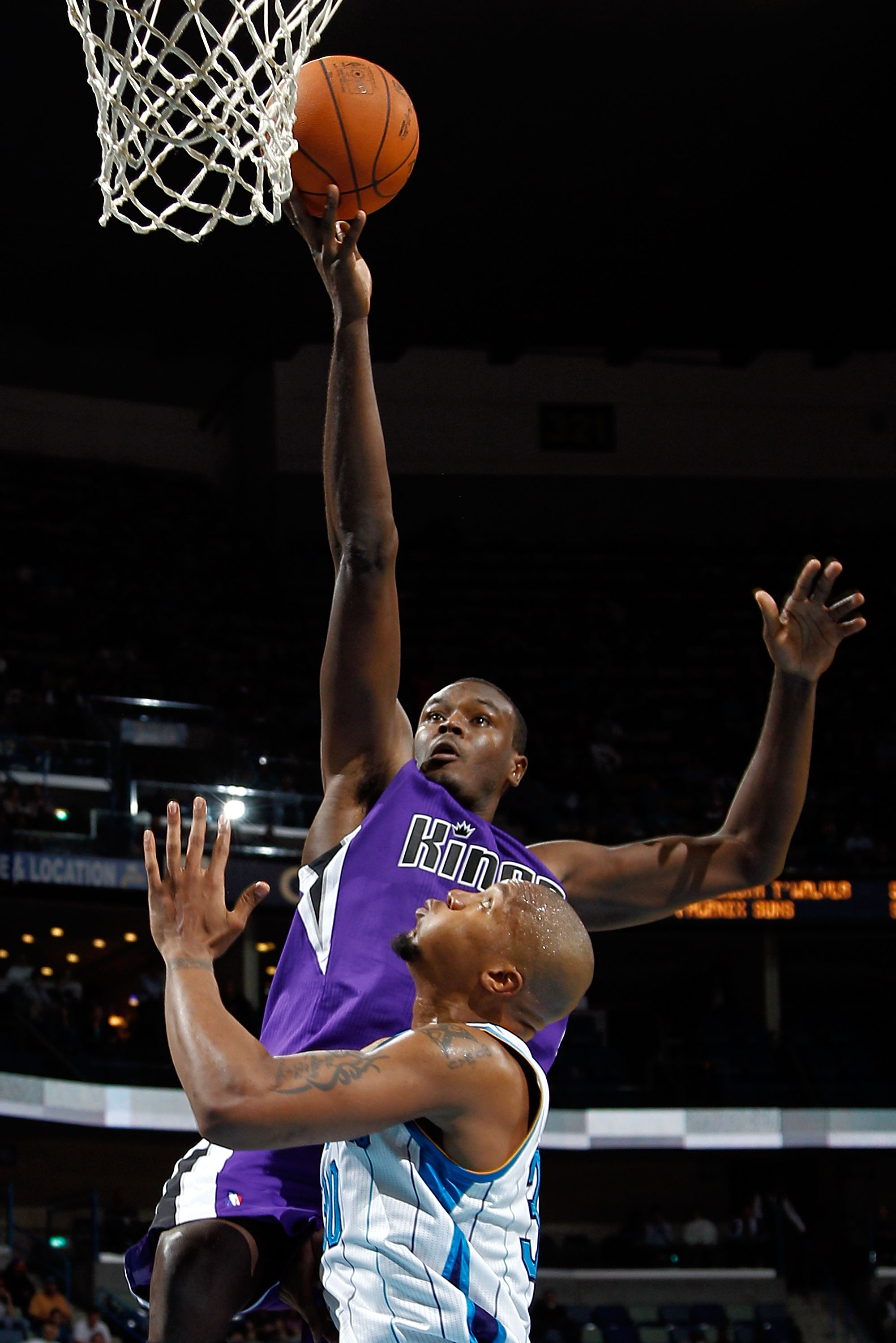 NEW ORLEANS, LA - DECEMBER 15:  Samuel Dalembert #10 of the Sacramento Kings shoots the ball over David West #30 of the New Orleans Hornets  at the New Orleans Arena on December 15, 2010 in New Orleans, Louisiana.  NOTE TO USER: User expressly acknowledge