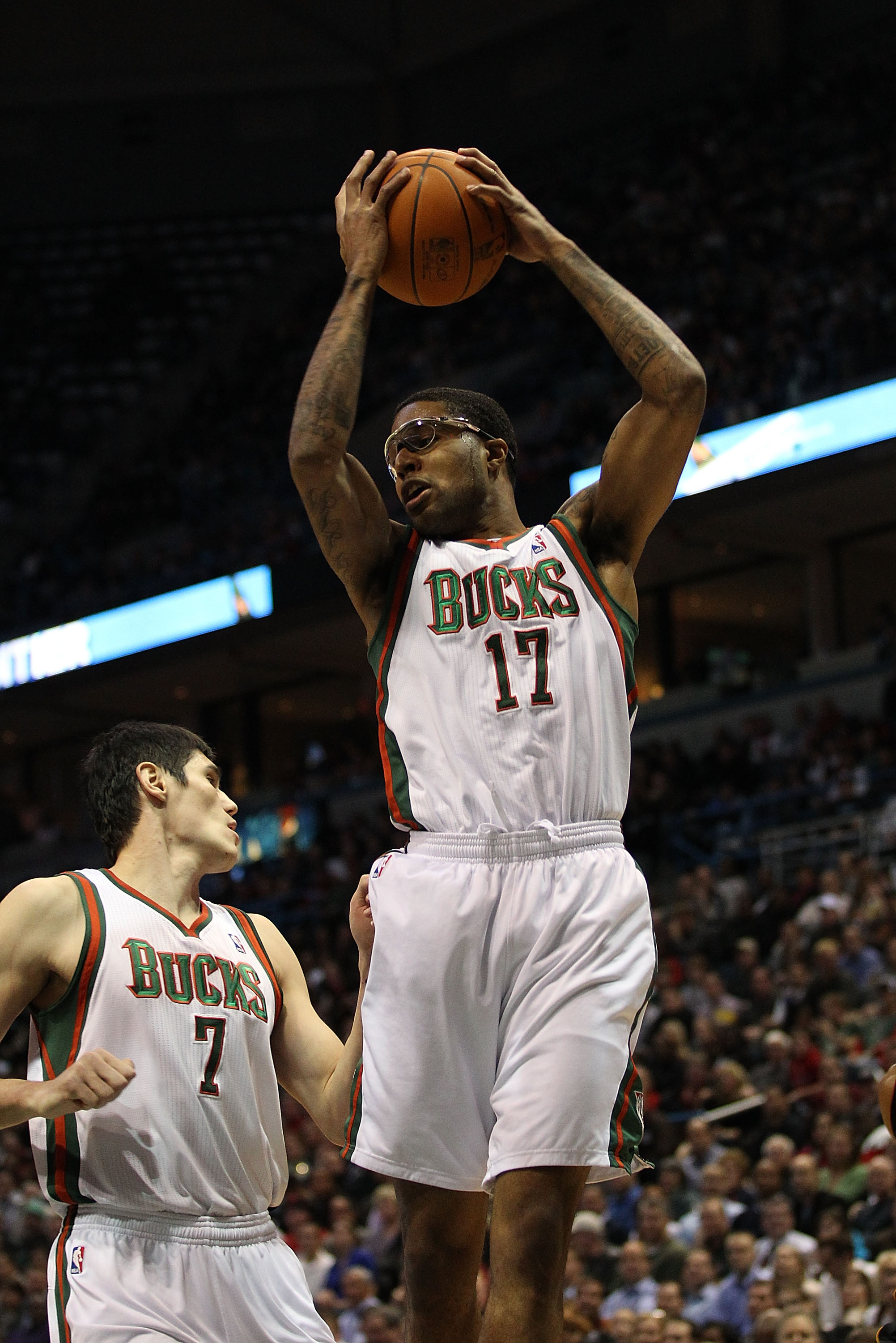 MILWAUKEE, WI - DECEMBER 06: Chris Douglas-Roberts #17 of the Milwaukee Bucks grabs a rebound over teammate Ersan Ilyasova #7 against the Miami Heat at the Bradley Center on December 6, 2010 in Milwaukee, Wisconsin. The Heat defeated the Bucks 88-78. NOTE