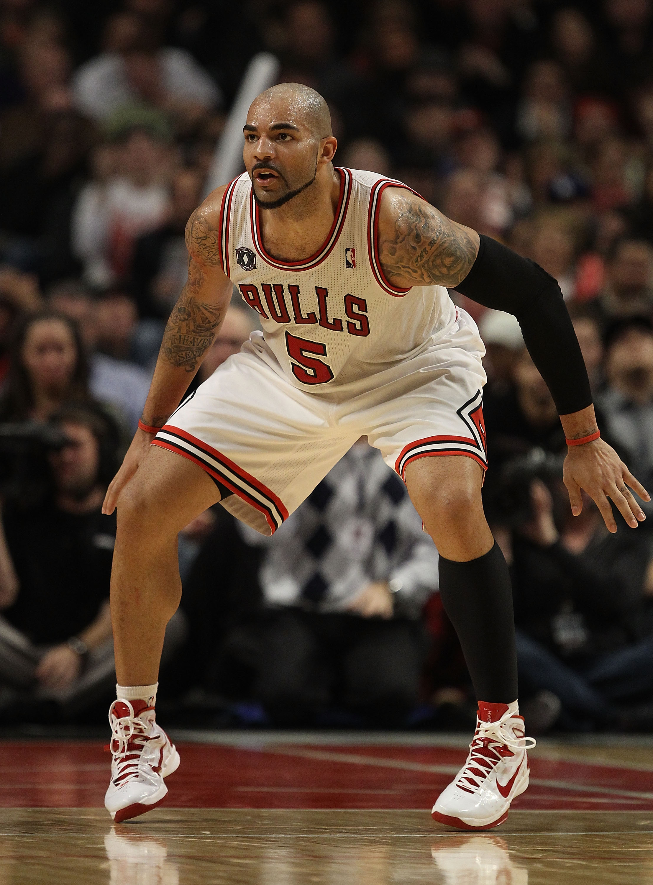 CHICAGO, IL - DECEMBER 10: Carlos Boozer #5 of the Chicago Bulls sets to defend against the Los Angeles Lakers at the United Center on December 10, 2010 in Chicago, Illinois. The Bulls defeated the Lakers 88-84. NOTE TO USER: User expressly acknowledges a