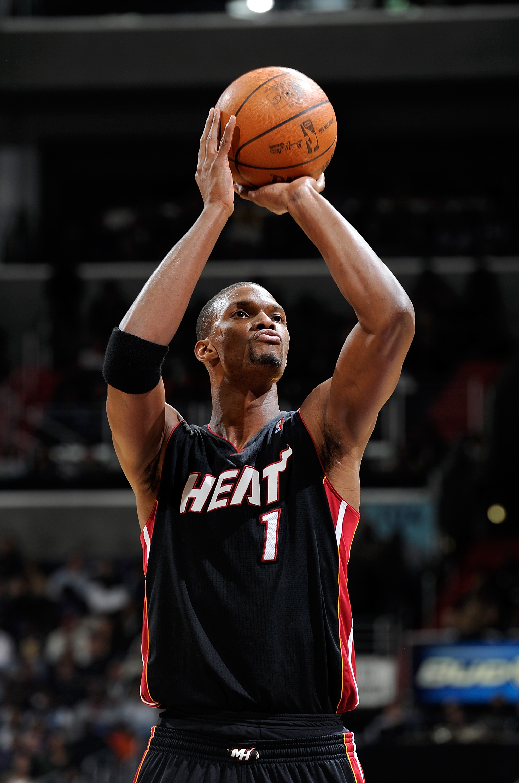 WASHINGTON, DC - DECEMBER 18:  Chris Bosh #1 of the Miami Heat shoots a free throw against the Washington Wizards at the Verizon Center on December 18, 2010 in Washington, DC. NOTE TO USER: User expressly acknowledges and agrees that, by downloading and o