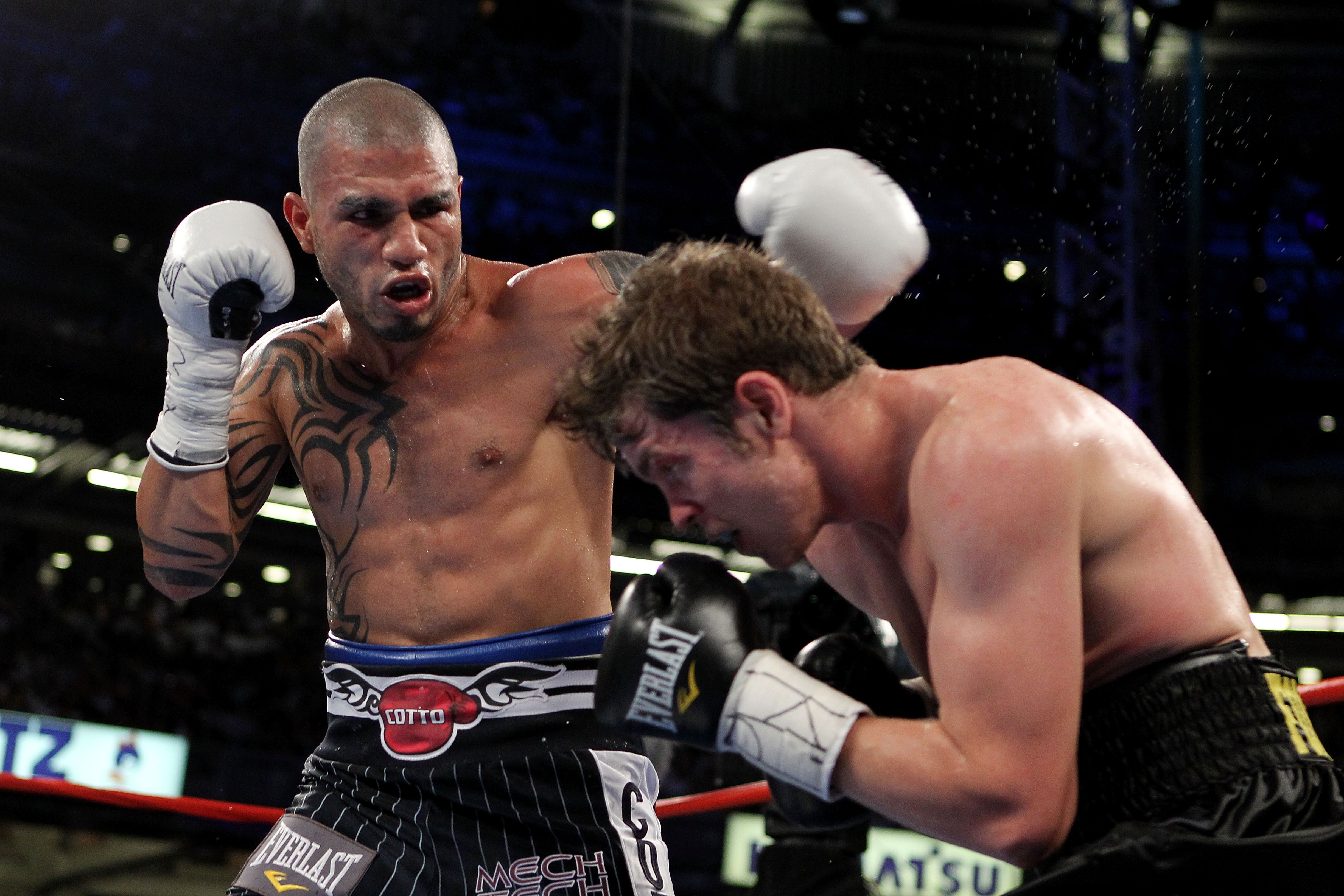 NEW YORK - JUNE 05:  (L-R) Miguel Cotto of Puerto Rico throws a left to the face of Yuri Foreman during the WBA world super welterweight title fight on June 5, 2010 at Yankee Stadium in the Bronx borough of New York City.  (Photo by Al Bello/Getty Images)