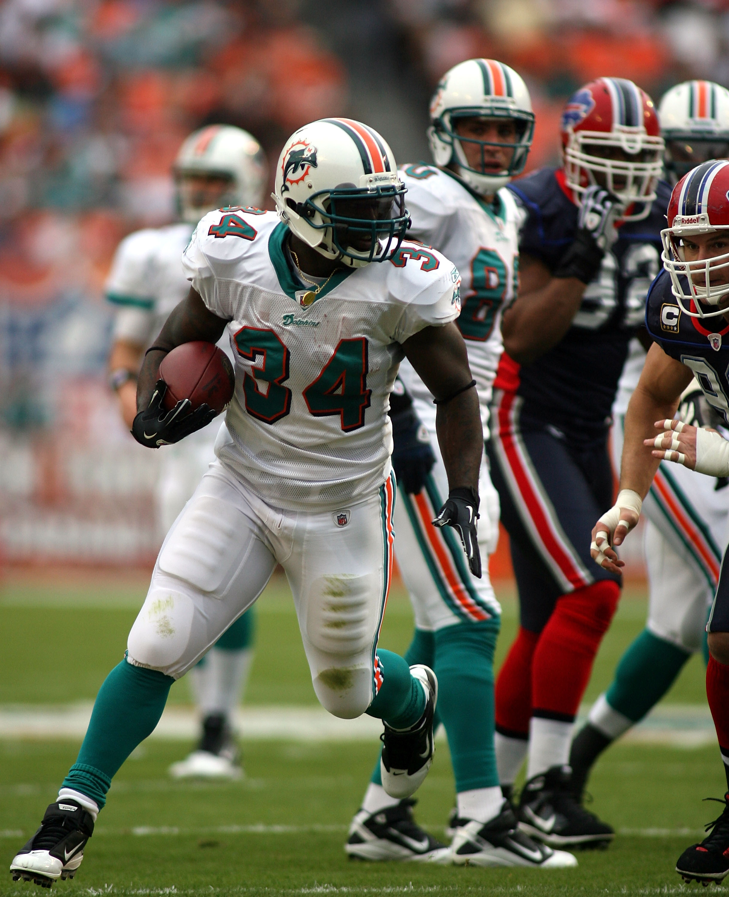 MIAMI - DECEMBER 19:  Running back Ricky Williams #34  of the Miami Dolphins is upended by the Buffalo Bills at Sun Life Stadium on December 19, 2010 in Miami, Florida. The Bills defeated the Dolphins 17-14.  (Photo by Marc Serota/Getty Images)