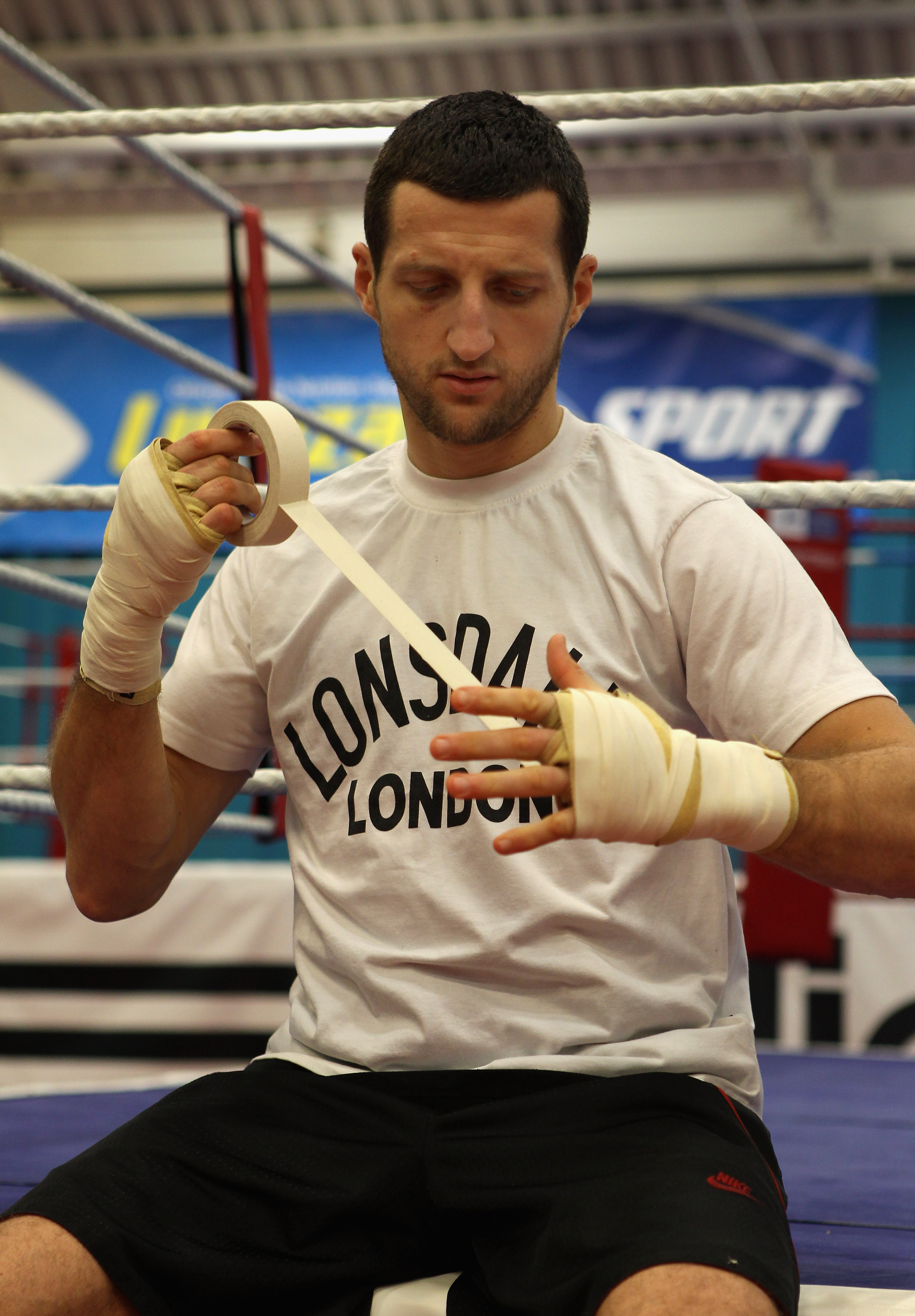 SHEFFIELD, ENGLAND - NOVEMBER 17:  Carl Froch wraps his hands up during a media training day ahead of his Super Six fight against Arthur Abraham at the English Institute of Sport on November 17, 2010 in Sheffield, England.  (Photo by Alex Livesey/Getty Im