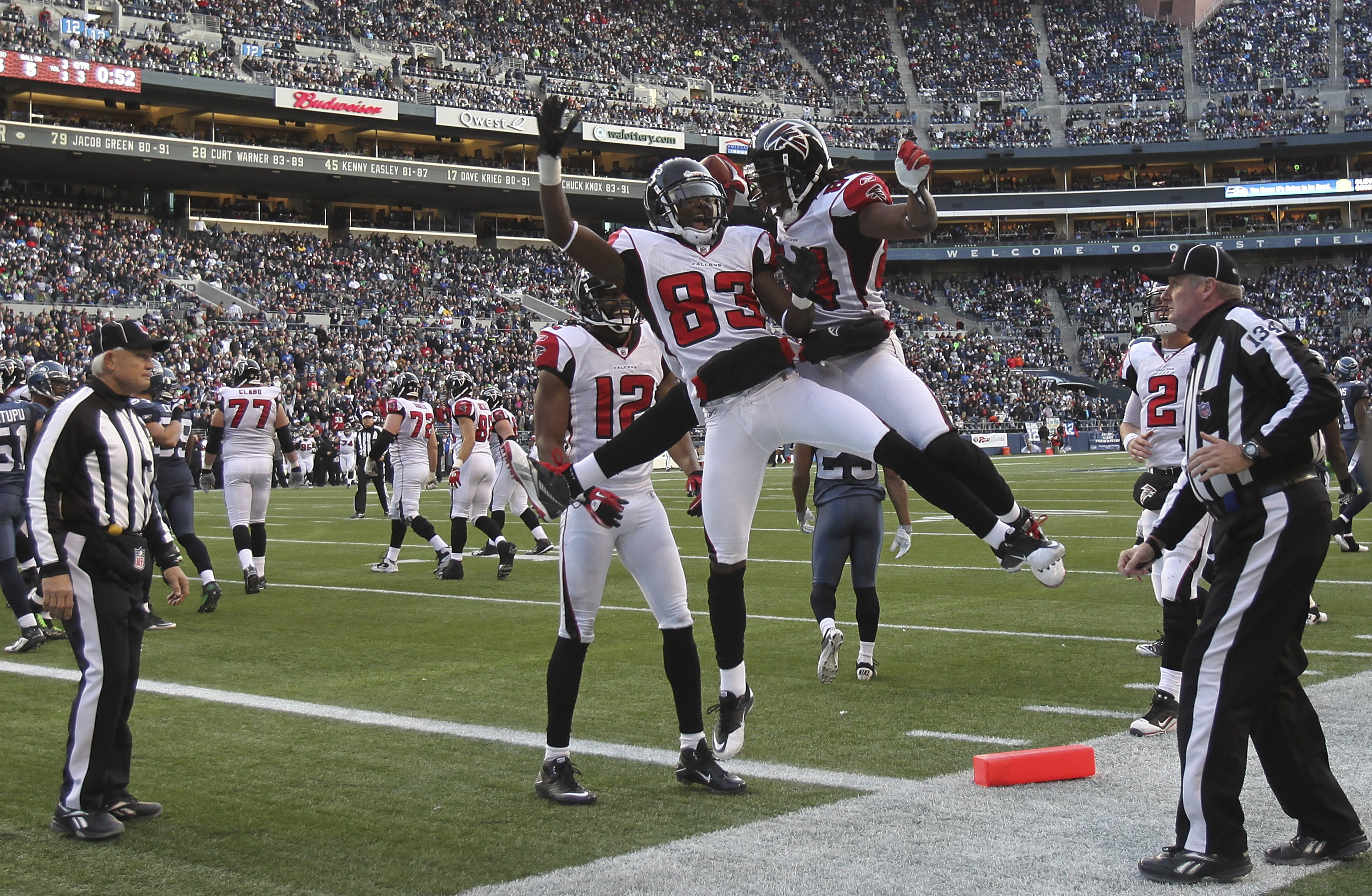 SEATTLE, WA - DECEMBER 19:  Wide receiver Roddy White #84 of the Atlanta Falcons celebrates with Harry Douglas #83 and Michael Jenkins #12 after scoring a touchdown against the Seattle Seahawks at Qwest Field on December 19, 2010 in Seattle, Washington. T