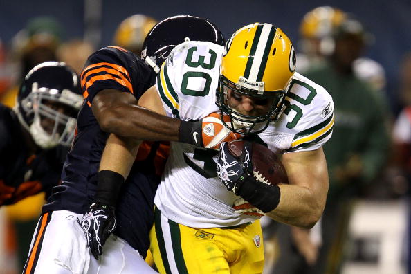 CHICAGO - SEPTEMBER 27:  John Kuhn #30 of the Green Bay Packers runs the ball against the Chicago Bears at Soldier Field on September 27, 2010 in Chicago, Illinois. The Bears won 20-17. (Photo by Jonathan Daniel/Getty Images)