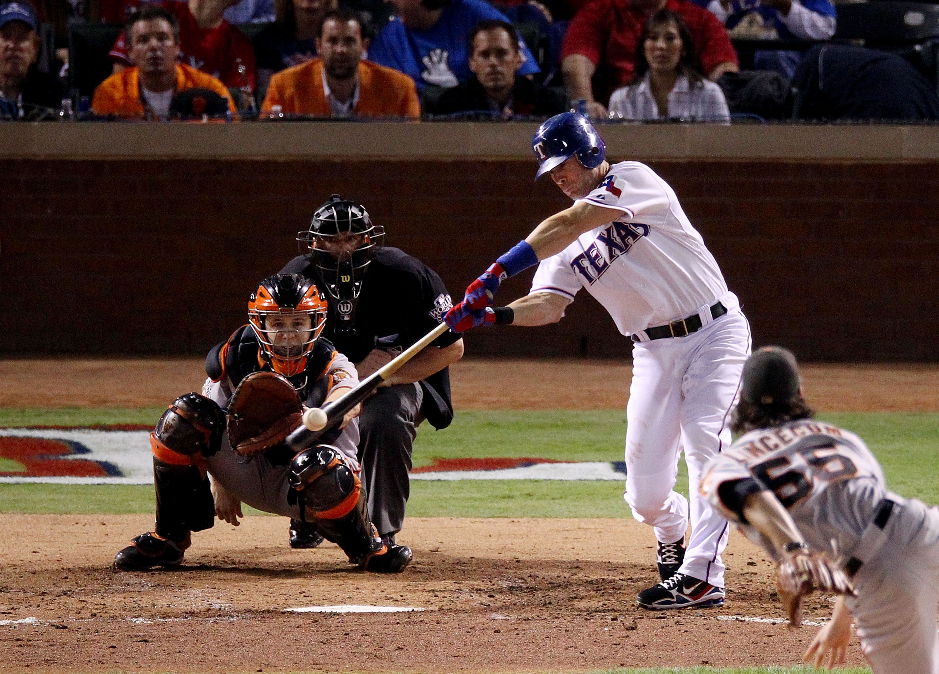 ARLINGTON, TX - NOVEMBER 01: Michael Young #10 of the Texas Rangers hits a single off starting pitcher Tim Lincecum #55 of the San Francisco Giants in the fifth inning of Game Five of the 2010 MLB World Series at Rangers Ballpark in Arlington on November