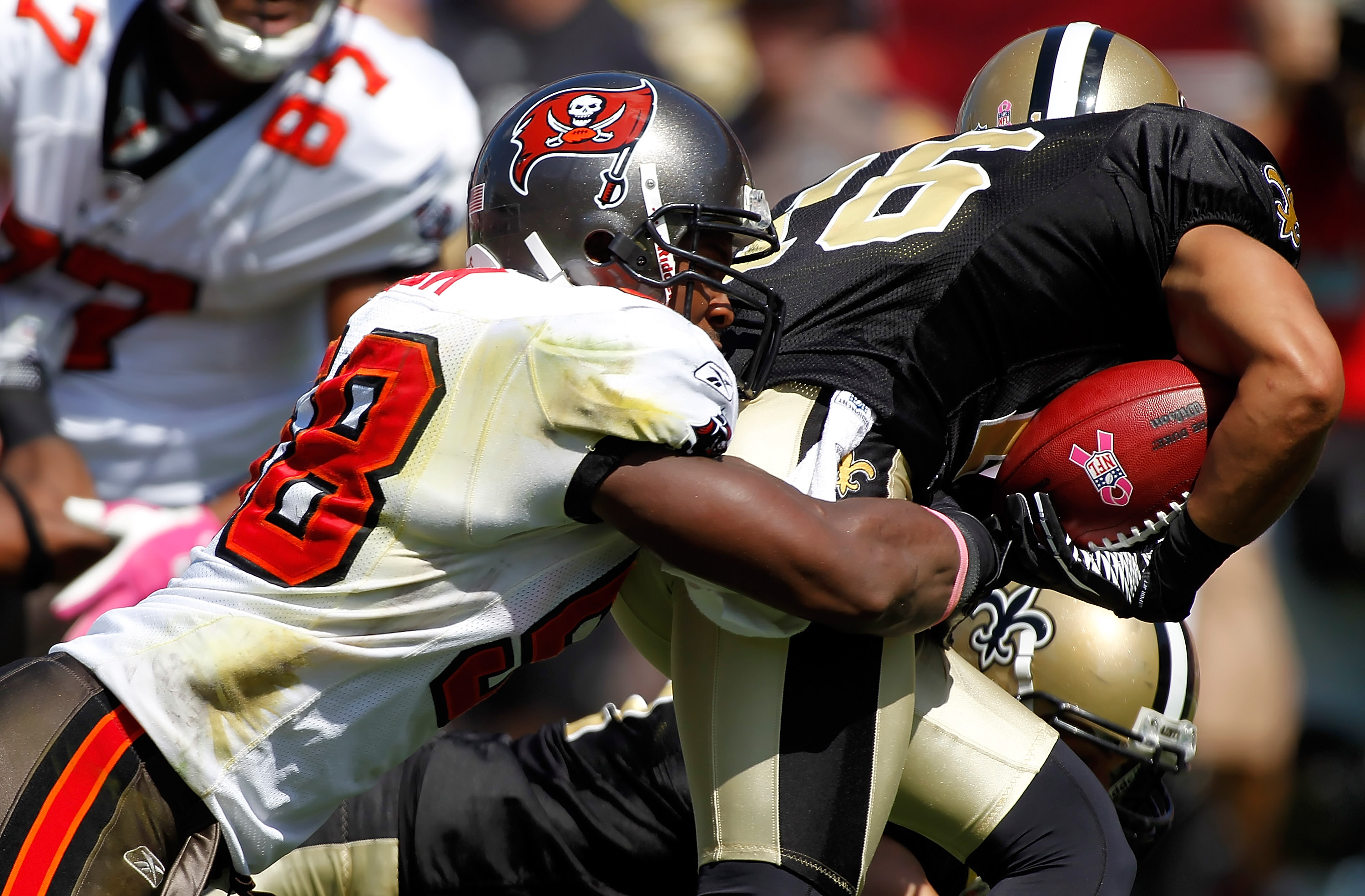 TAMPA, FL - OCTOBER 17:  Linebacker Quincy Black #58 of the Tampa Bay Buccaneers tackles Lance Moore #16 of the New Orleans Saints on a return during the game at Raymond James Stadium on October 17, 2010 in Tampa, Florida.  (Photo by J. Meric/Getty Images