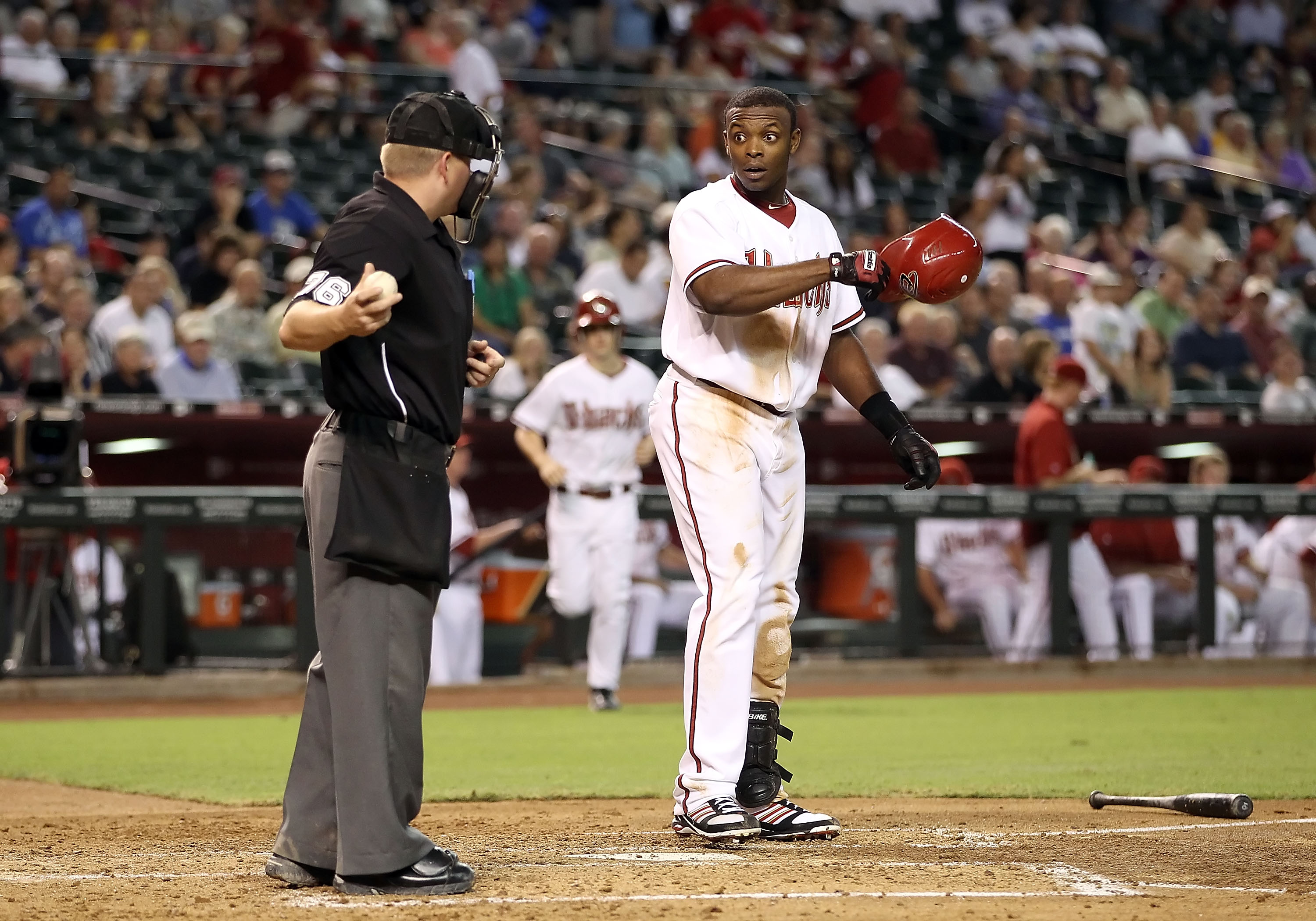 PHOENIX - AUGUST 30:  Justin Upton #24 of the Arizona Diamondbacks reacts after striking out during the Major League Baseball game against the San Diego Padres at Chase Field on August 30, 2010 in Phoenix, Arizona. The Diamondbacks defeated the Padres 7-2