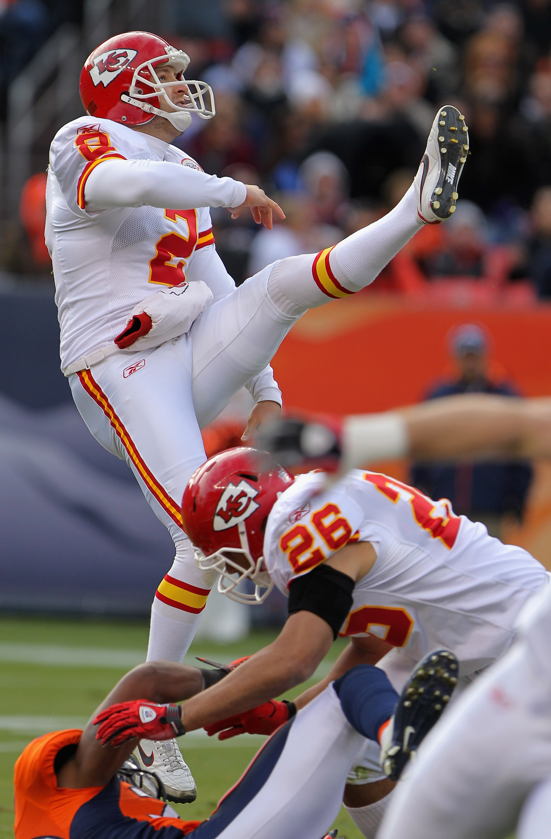 DENVER - NOVEMBER 14:  Punter Dustin Colquitt #2 of the Kansas City Chiefs follows through on a punt against the Denver Bronco at INVESCO Field at Mile High on November 14, 2010 in Denver, Colorado. The Broncos defeated the Chiefs 49-29.  (Photo by Doug P