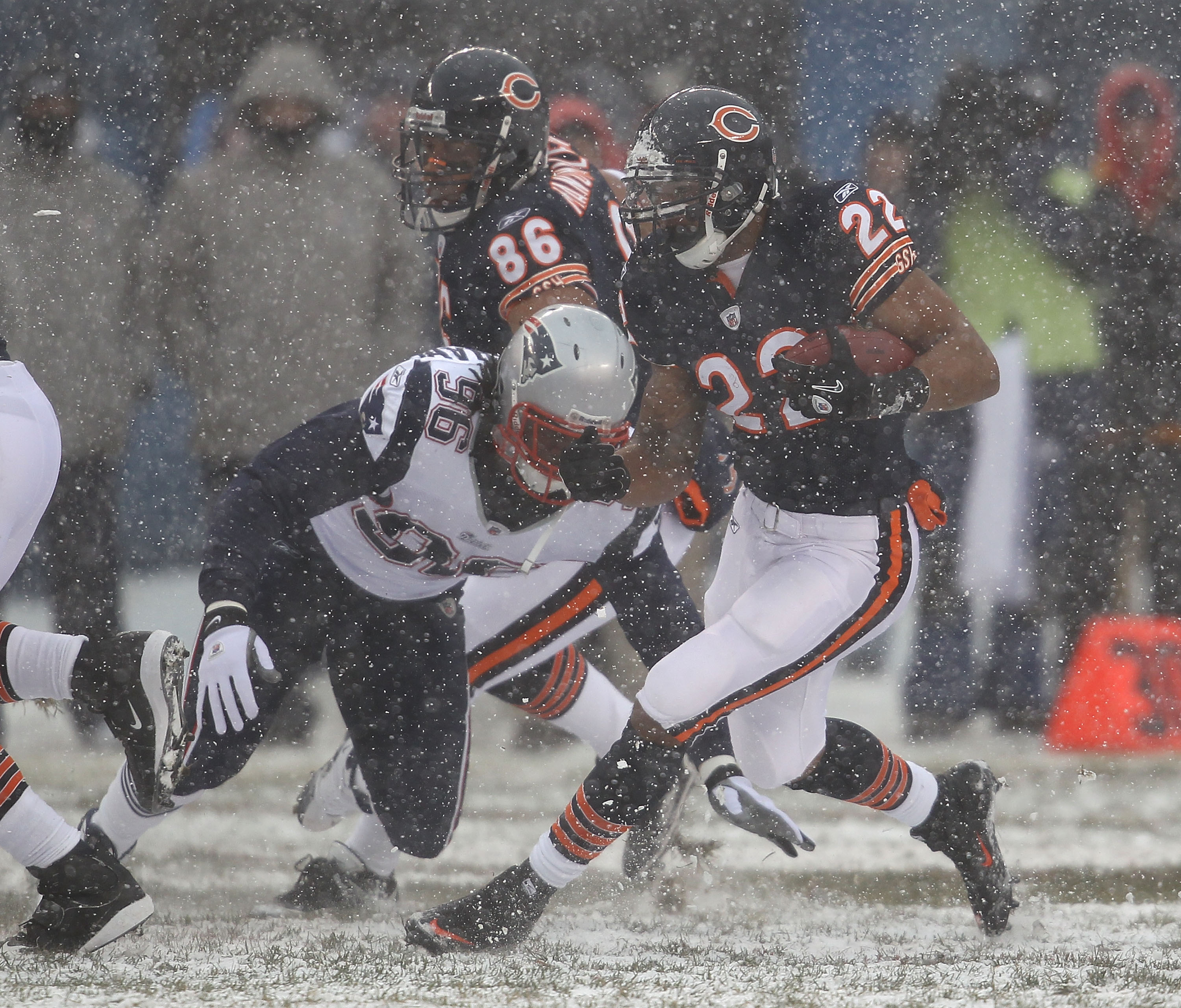 CHICAGO, IL - DECEMBER 12: Matt Forte #22 of the Chicago Bears avoids a tackle attempt by Jermaine Cunningham #96 of the New England Patriots at Soldier Field on December 12, 2010 in Chicago, Illinois. The Patriots defeated the Bears 36-7. (Photo by Jonat