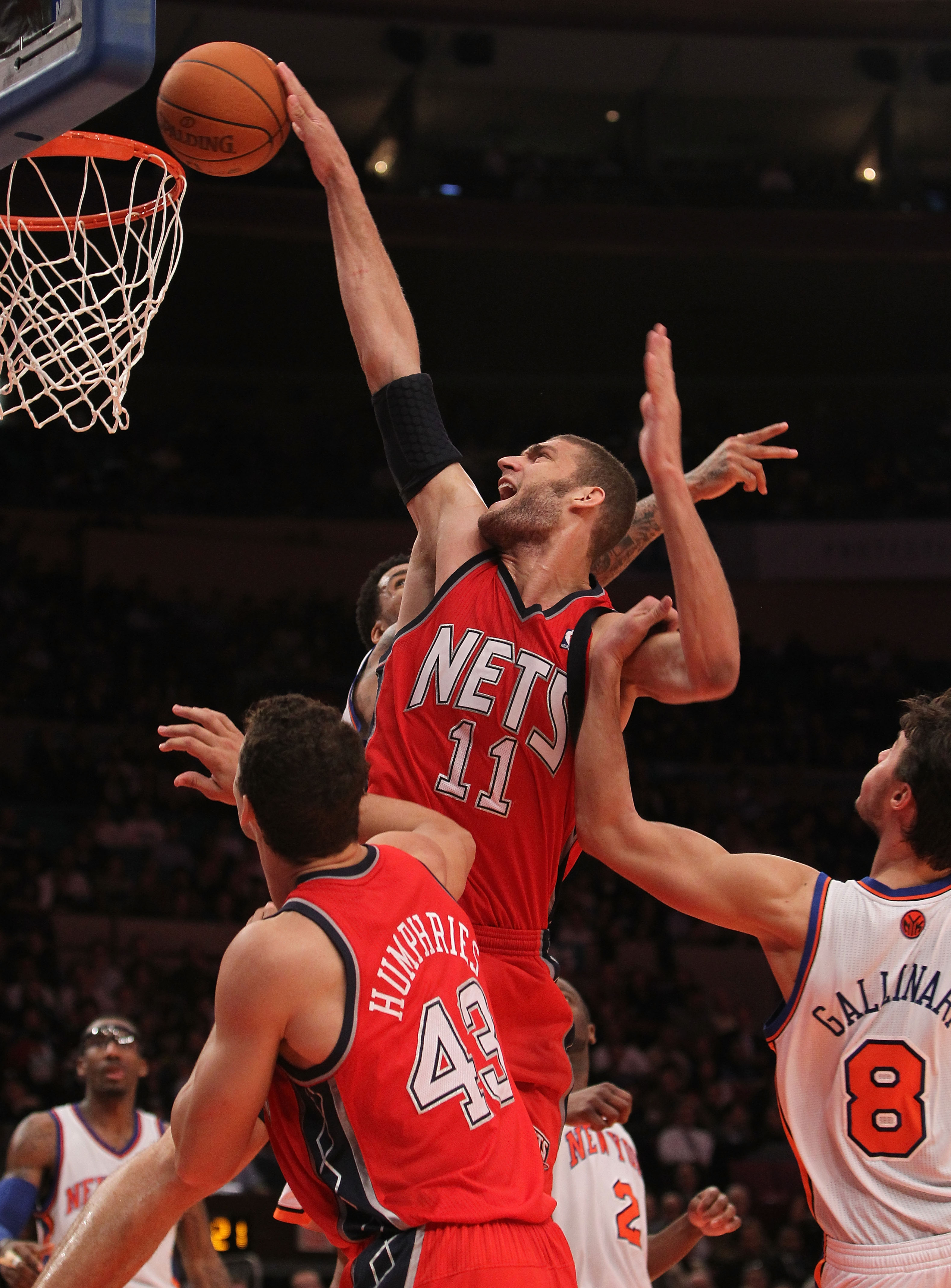 NEW YORK, NY - NOVEMBER 30: Brook Lopez #11 of the of the New Jersey Nets is fouled by Danilo Gallinari #8 of the New York Knicks on November 30, 2010 at Madison Square Garden in New York City. NOTE TO USER: User expressly acknowledges and agrees that, by
