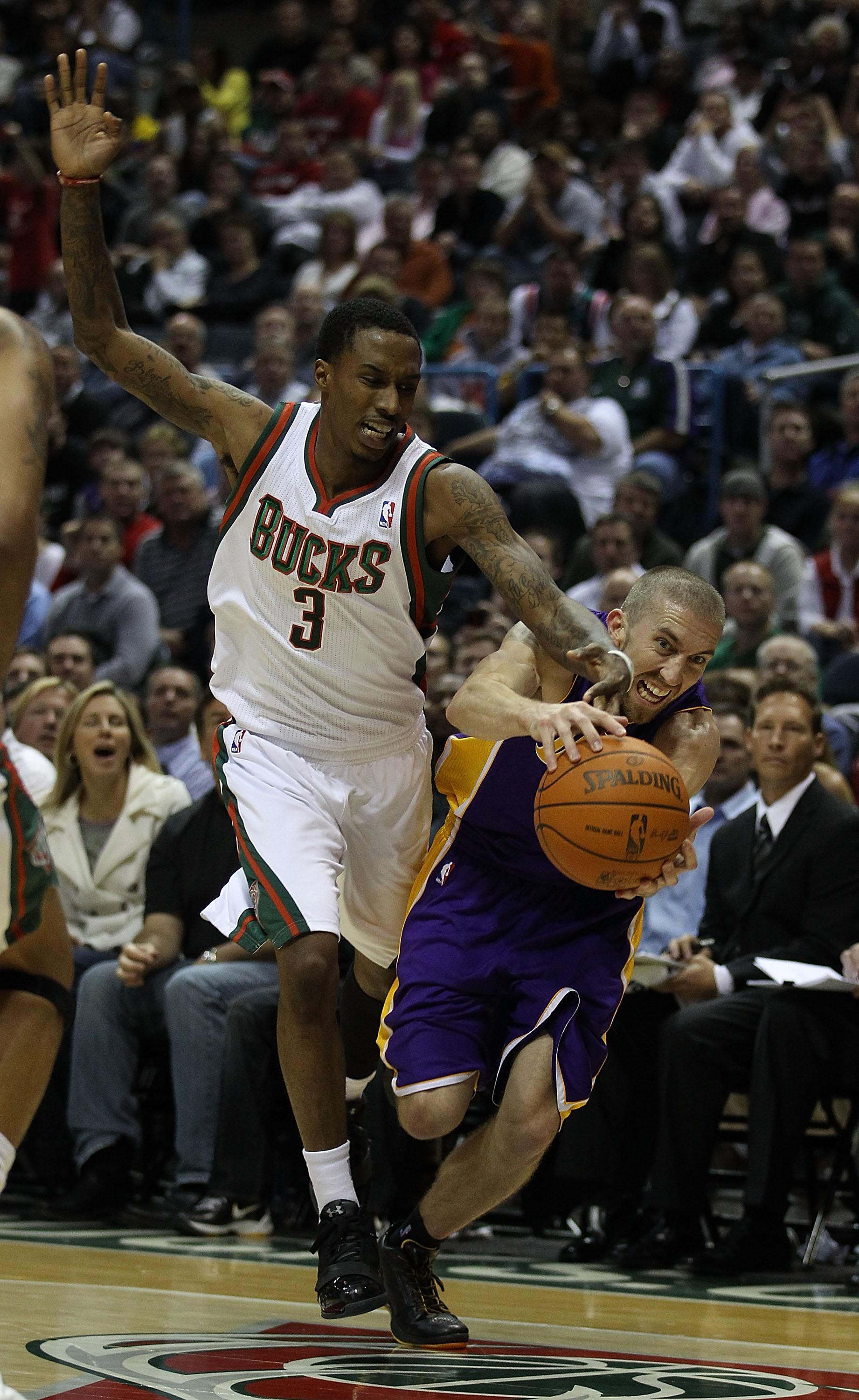 MILWAUKEE - NOVEMBER 16: Brandon Jennings #3 of the Milwaukee Bucks and Steve Blake #5 of the Los Angeles Lakers battle for a loose ball at the Bradley Center on November 16, 2010 in Milwaukee, Wisconsin. The Lakers defeated the Bucks 118-107. NOTE TO USE