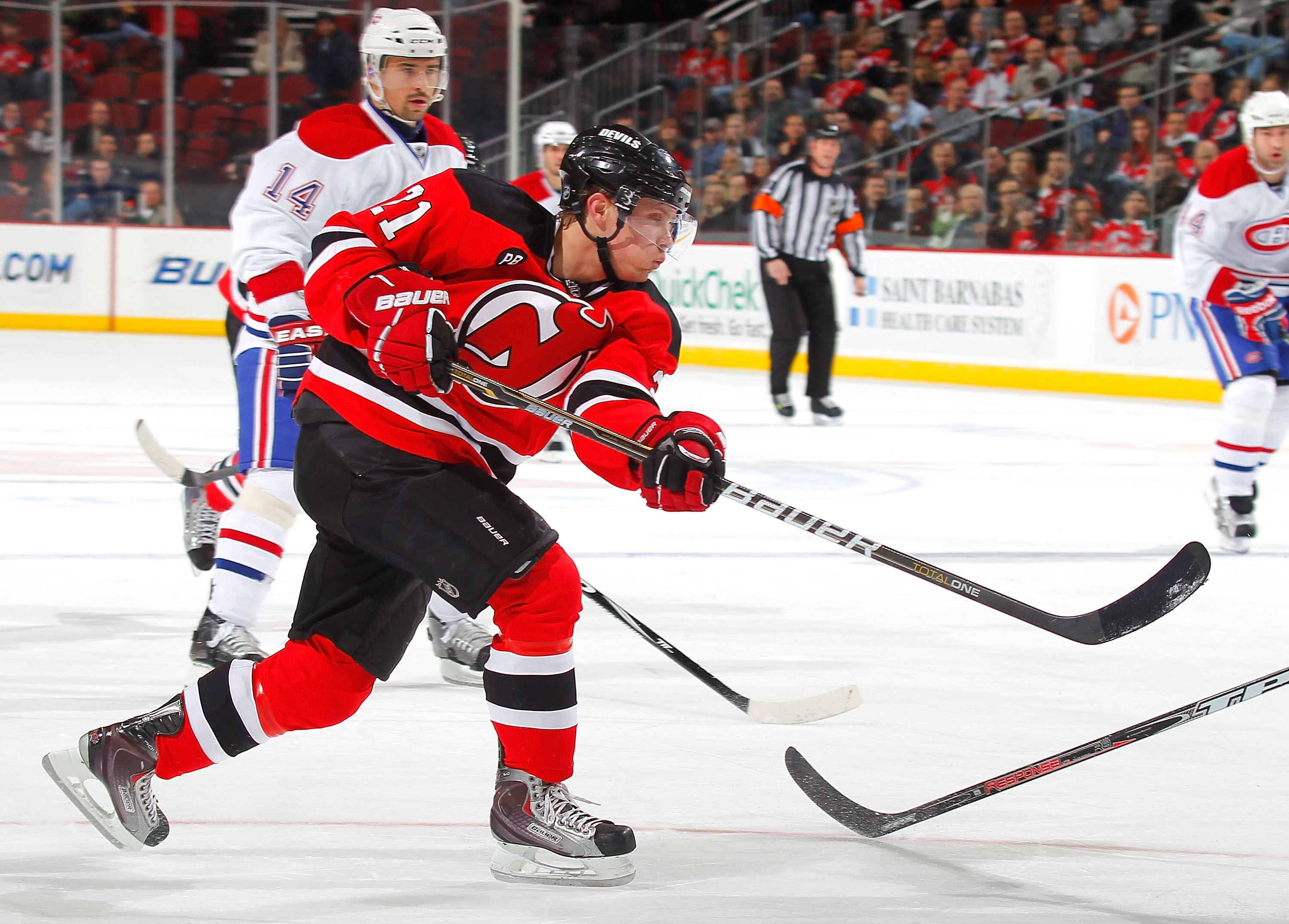 NEWARK, NJ - DECEMBER 02:  Mattias Tedenby #21 of the New Jersey Devils shoots during a hockey game against the Montreal Canadiens at the Prudential Center on December 2, 2010 in Newark, New Jersey.  (Photo by Paul Bereswill/Getty Images)