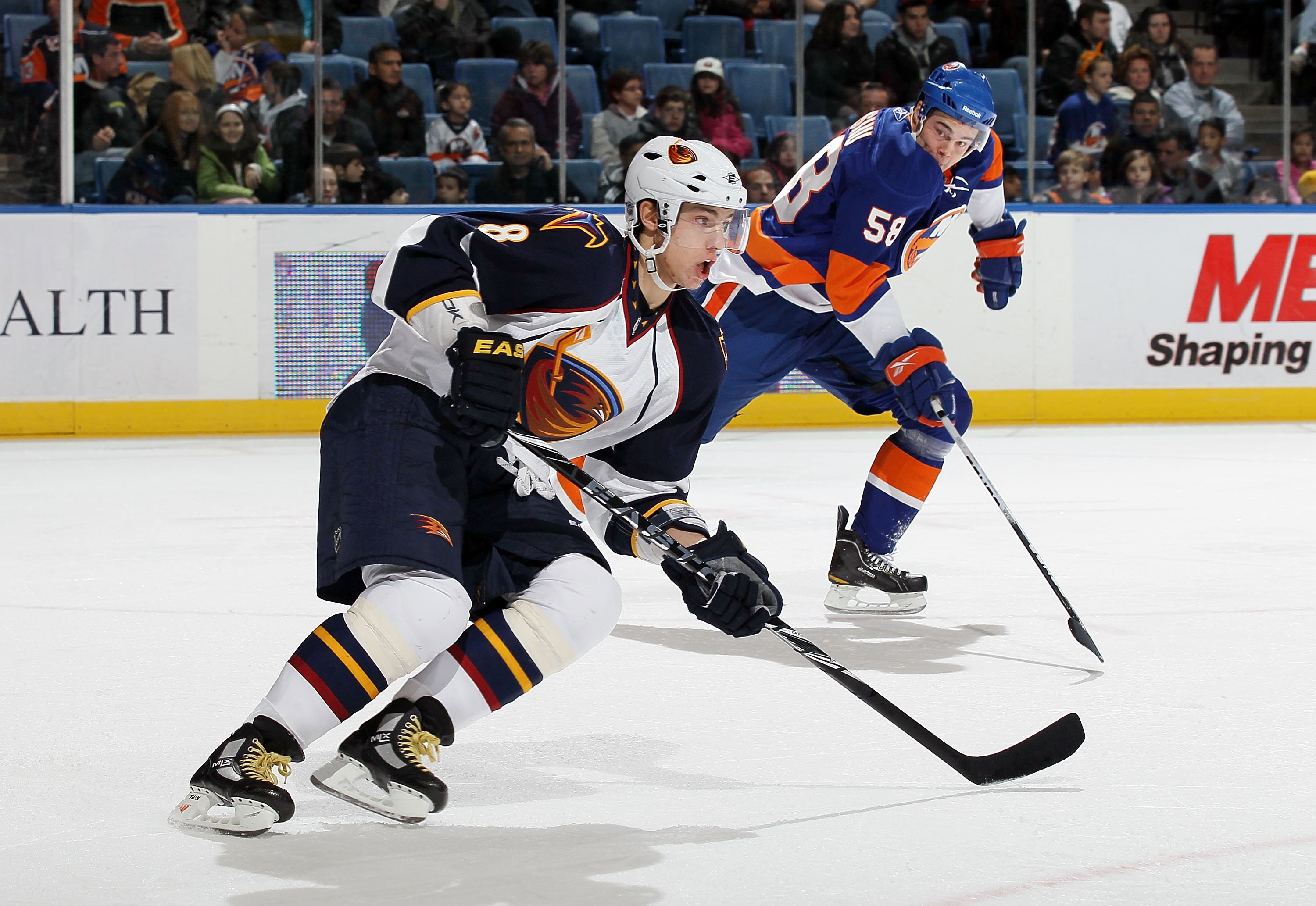 UNIONDALE, NY - DECEMBER 11:  Alexander Burmistrov #8 of the Atlanta Thrashers skates against the New York Islanders on December 11, 2010 at Nassau Coliseum in Uniondale, New York. The Thrashers defeated the Isles 5-4.  (Photo by Jim McIsaac/Getty Images)