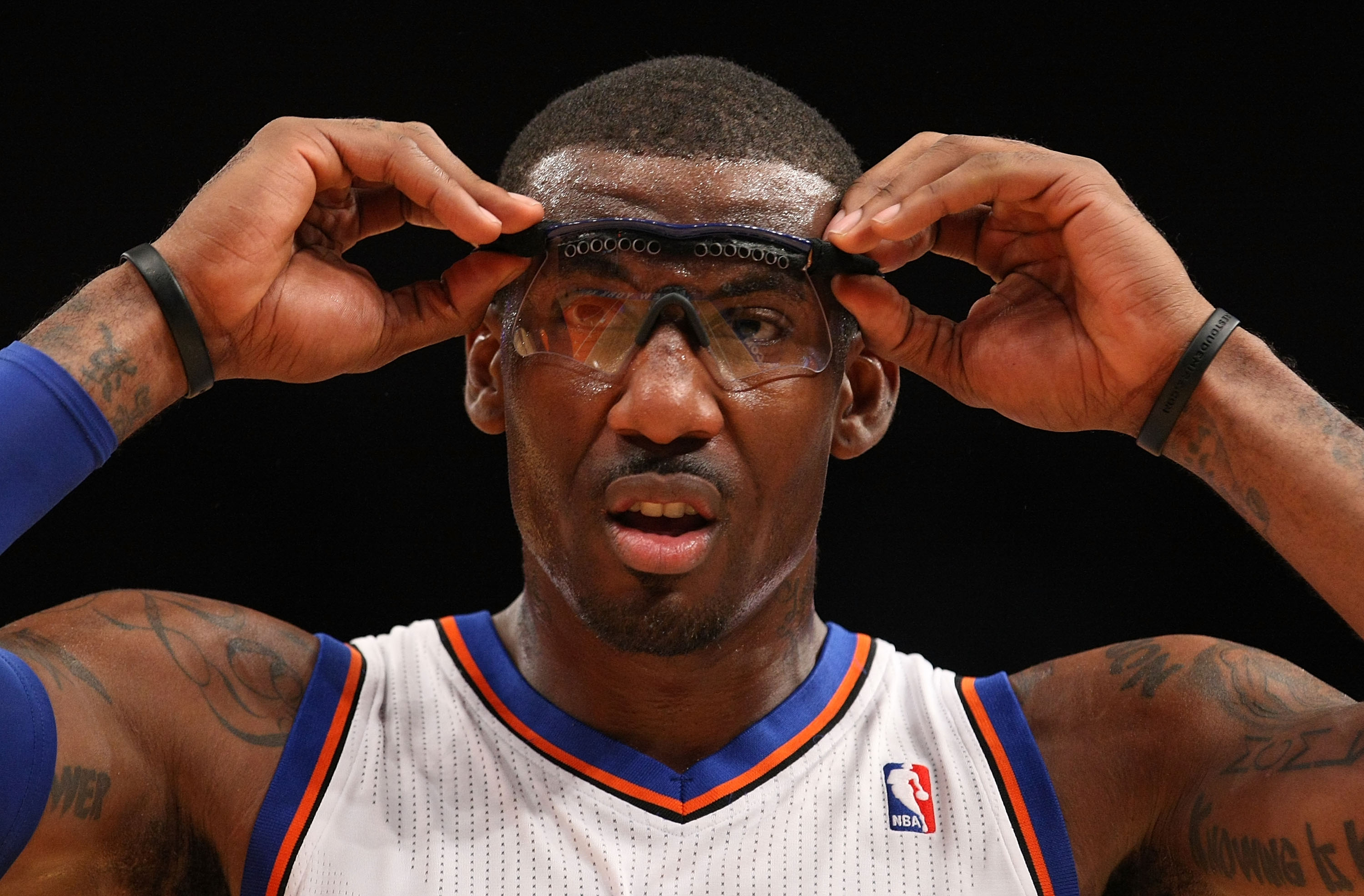 NEW YORK, NY - DECEMBER 17:  Amar'e Stoudemire #1 of the New York Knicks adjusts his goggles against  the Miami Heat at Madison Square Garden on December 17, 2010 in New York City. NOTE TO USER: User expressly acknowledges and agrees that, by downloading
