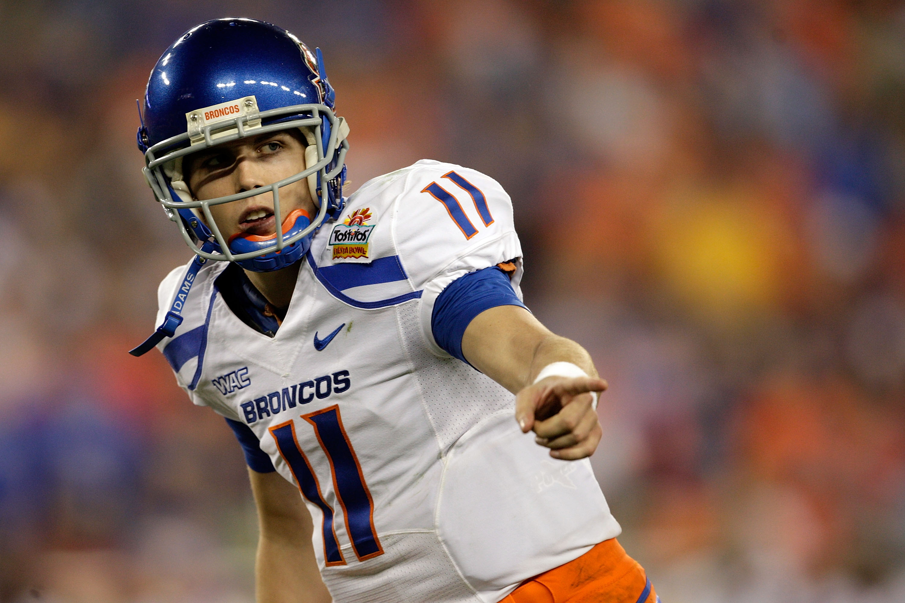 GLENDALE, AZ - JANUARY 04:  Quarterback Kellen Moore #11 of the Boise State Broncos points in the first half against the TCU Horned Frogs during the Tostitos Fiesta Bowl at the Universtity of Phoenix Stadium on January 4, 2010 in Glendale, Arizona.  (Phot
