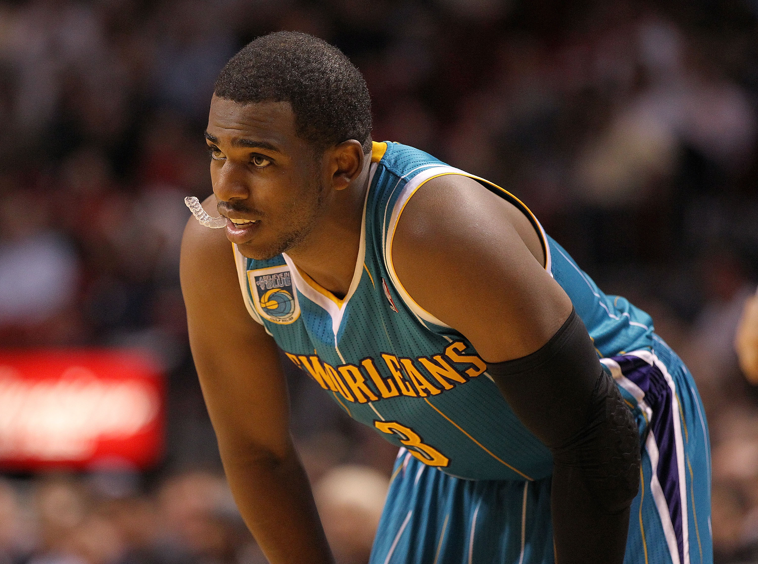 MIAMI, FL - DECEMBER 13: Chris Paul #3 of the New Orleans Hornets waits during a foul shot during a game against the Miami Heat at American Airlines Arena on December 13, 2010 in Miami, Florida. NOTE TO USER: User expressly acknowledges and agrees that, b