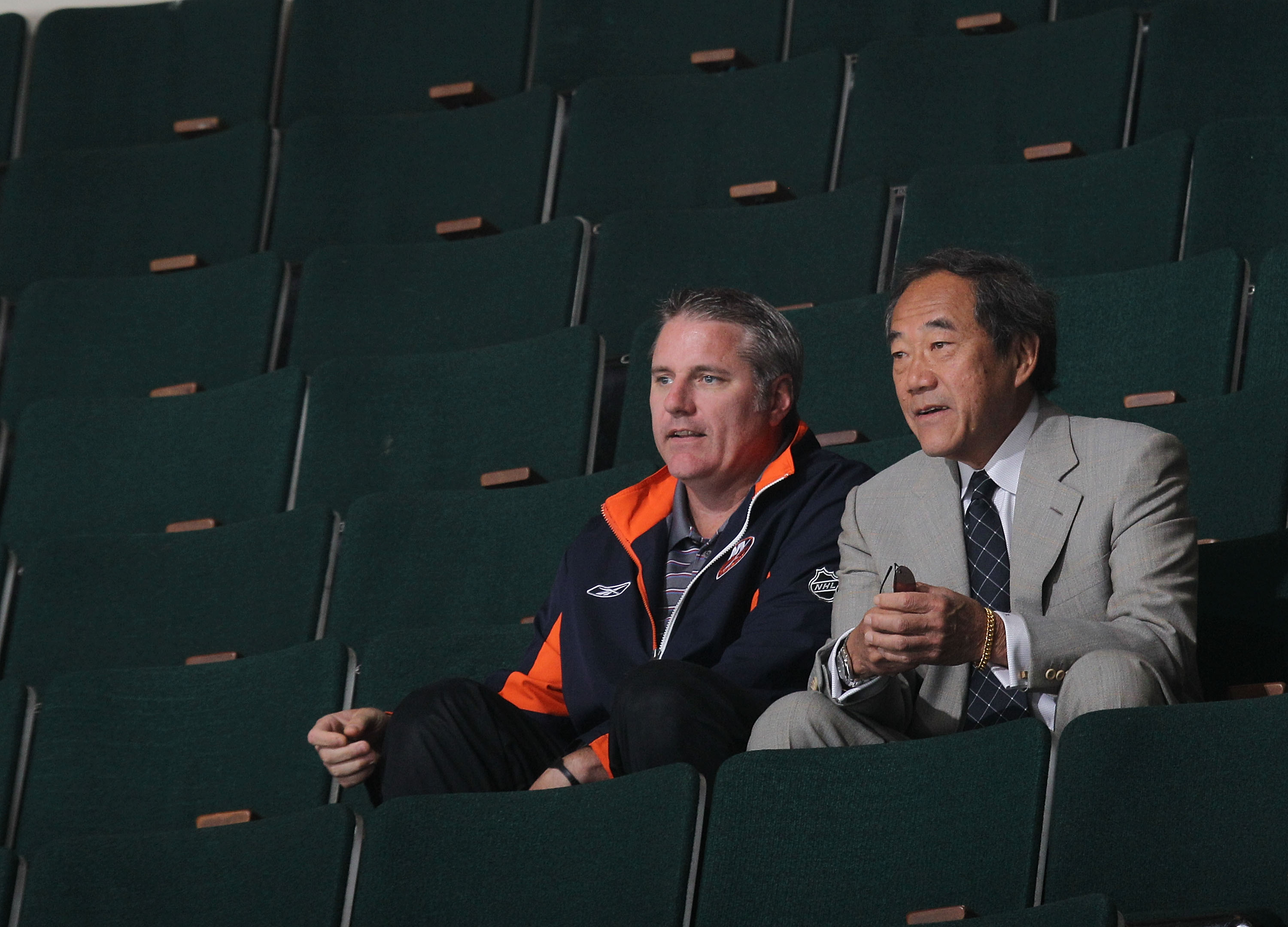 UNIONDALE, NY - JULY 07: General Manager Garth Snow and team owner Charles Wang watch the New York Islanders rookie camp at Nassau Veterans Memorial Coliseum on July 7, 2010 in Uniondale, New York. (Photo by Bruce Bennett/Getty Images)