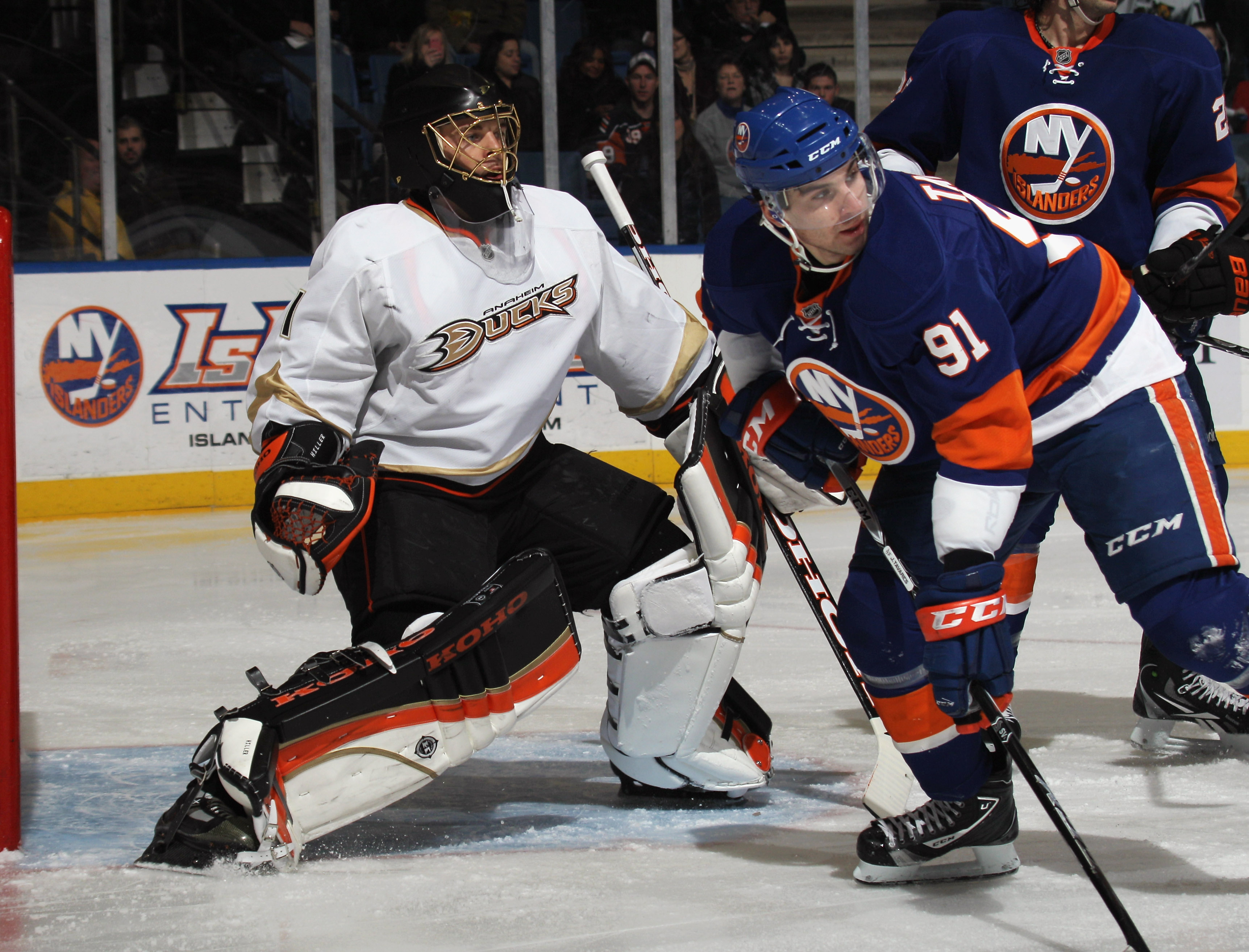 UNIONDALE, NY - DECEMBER 16:  Jonas Hiller #1 of the Anaheim Ducks tends net against John Tavares #91 of the New York Islanders the New York Islanders at the Nassau Coliseum on December 16, 2010 in Uniondale, New York.  (Photo by Bruce Bennett/Getty Image