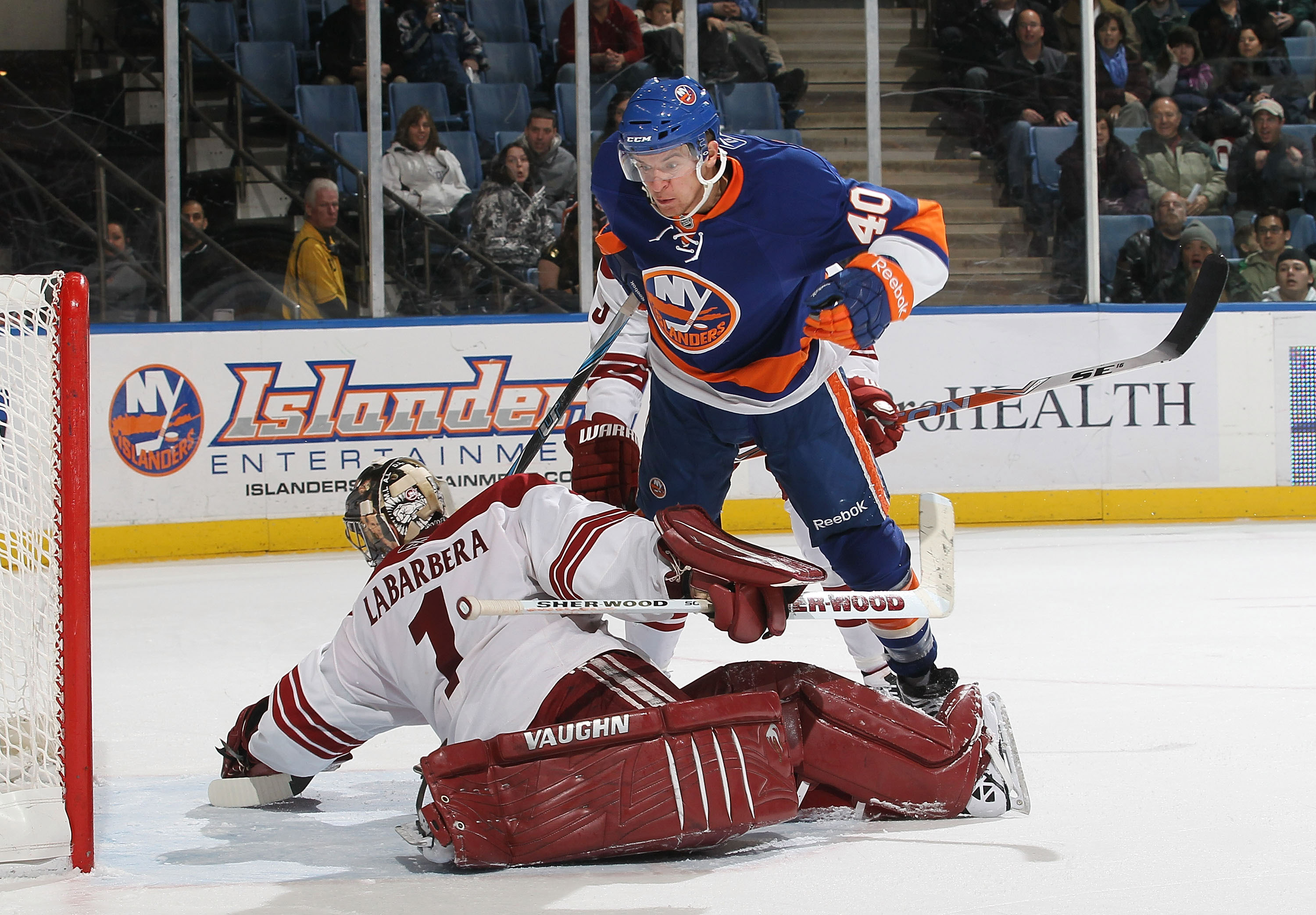 UNIONDALE, NY - DECEMBER 18: Michael Grabner #40 of the New York Islanders scores a goal against Jason LaBarbera #1 of the Phoenix Coyotes during their game on December 18, 2010 at the Nassau Coliseum in Uniondale, New York.  (Photo by Al Bello/Getty Imag