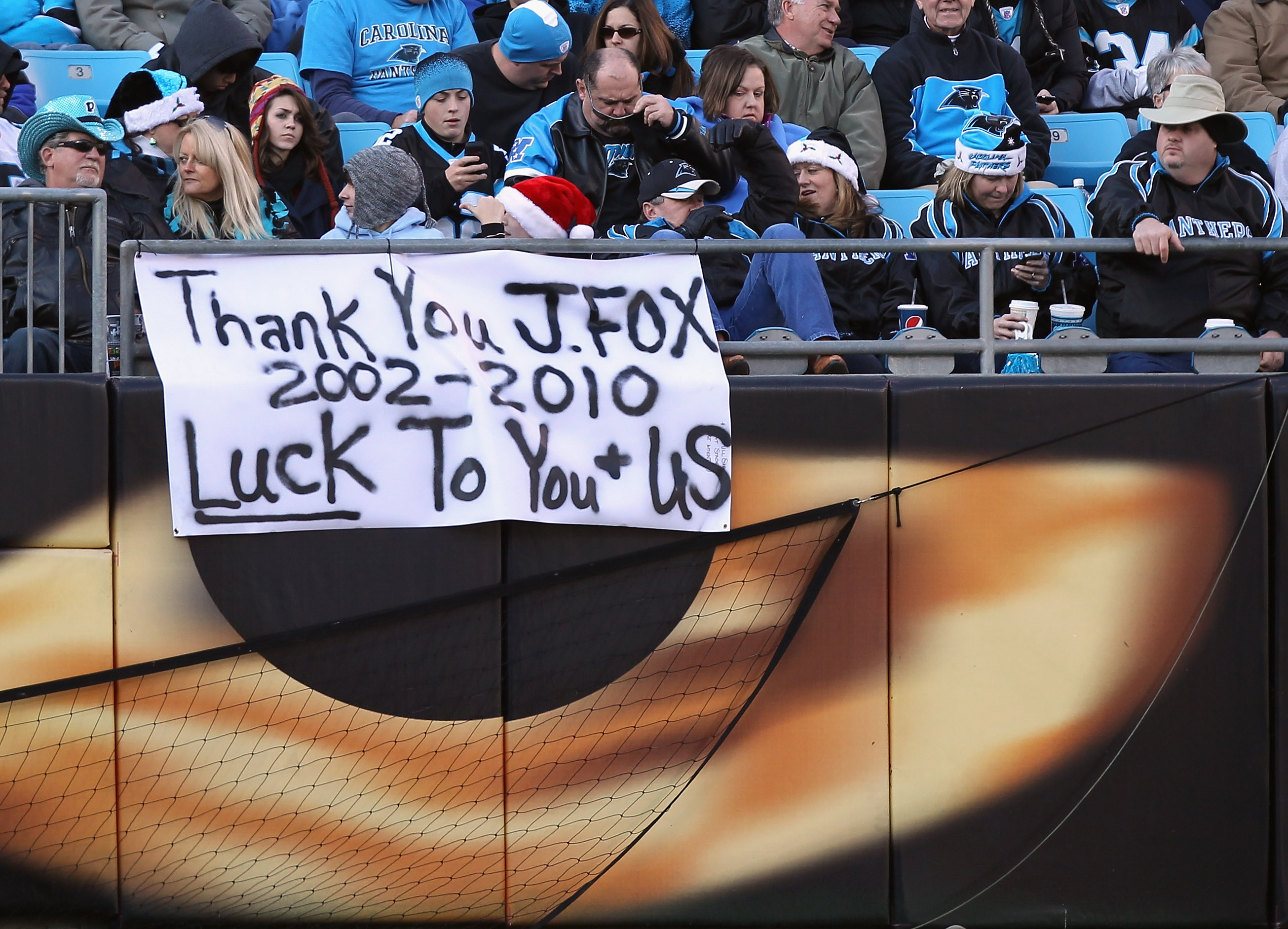 CHARLOTTE, NC - DECEMBER 19:  Fans hang a sign for head coach John Fox of the Carolina Panthers during their game against the Arizona Cardinals at Bank of America Stadium on December 19, 2010 in Charlotte, North Carolina.  (Photo by Streeter Lecka/Getty I