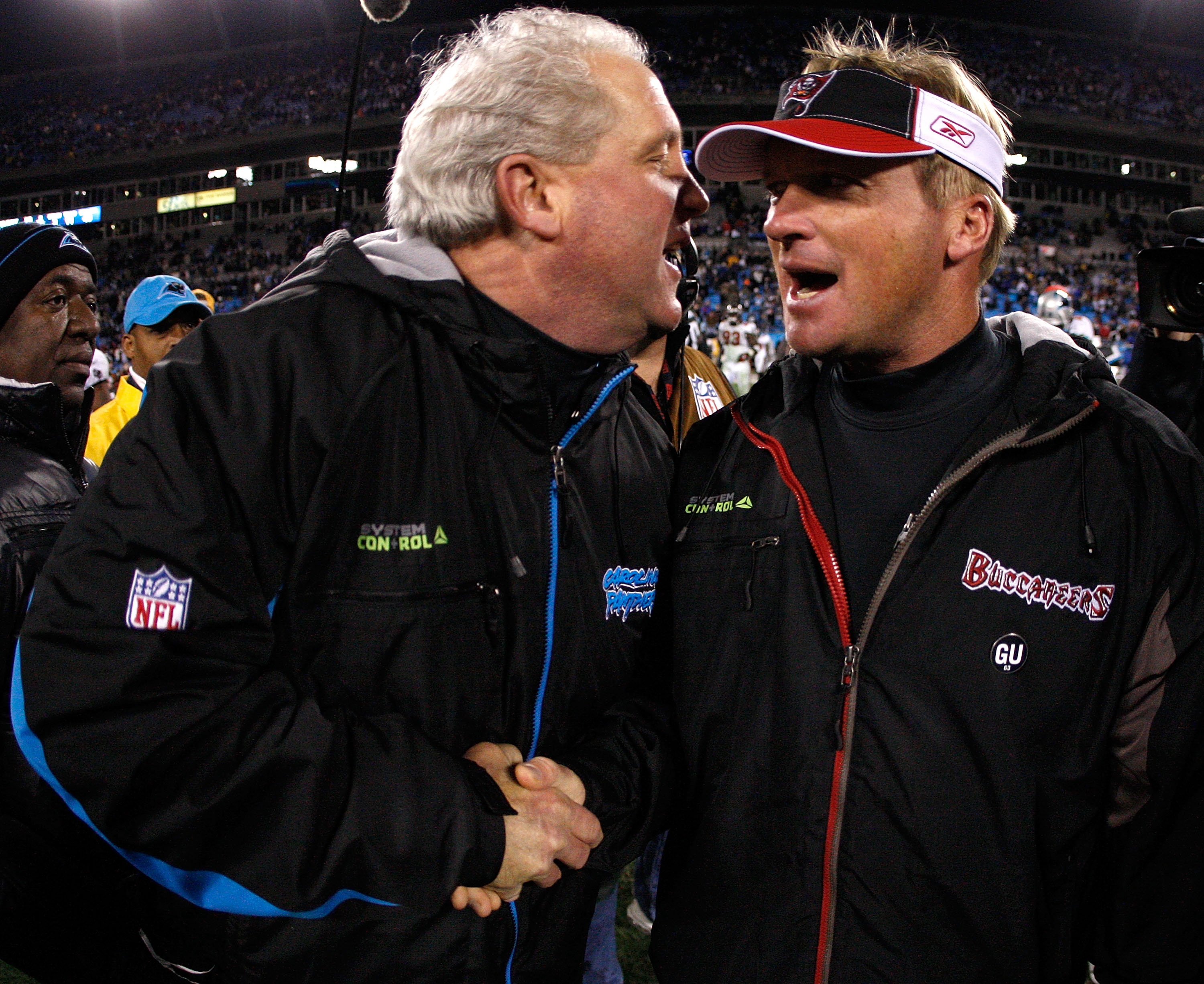 CHARLOTTE, NC - DECEMBER 08:  Head coach Jon Gruden (R) of the Tampa Bay Buccaneers shakes hands with head coach John Fox (L) of the Carolina Panthers after the game at Bank of America Stadium on December 8, 2008 in Charlotte, North Carolina.  (Photo by S