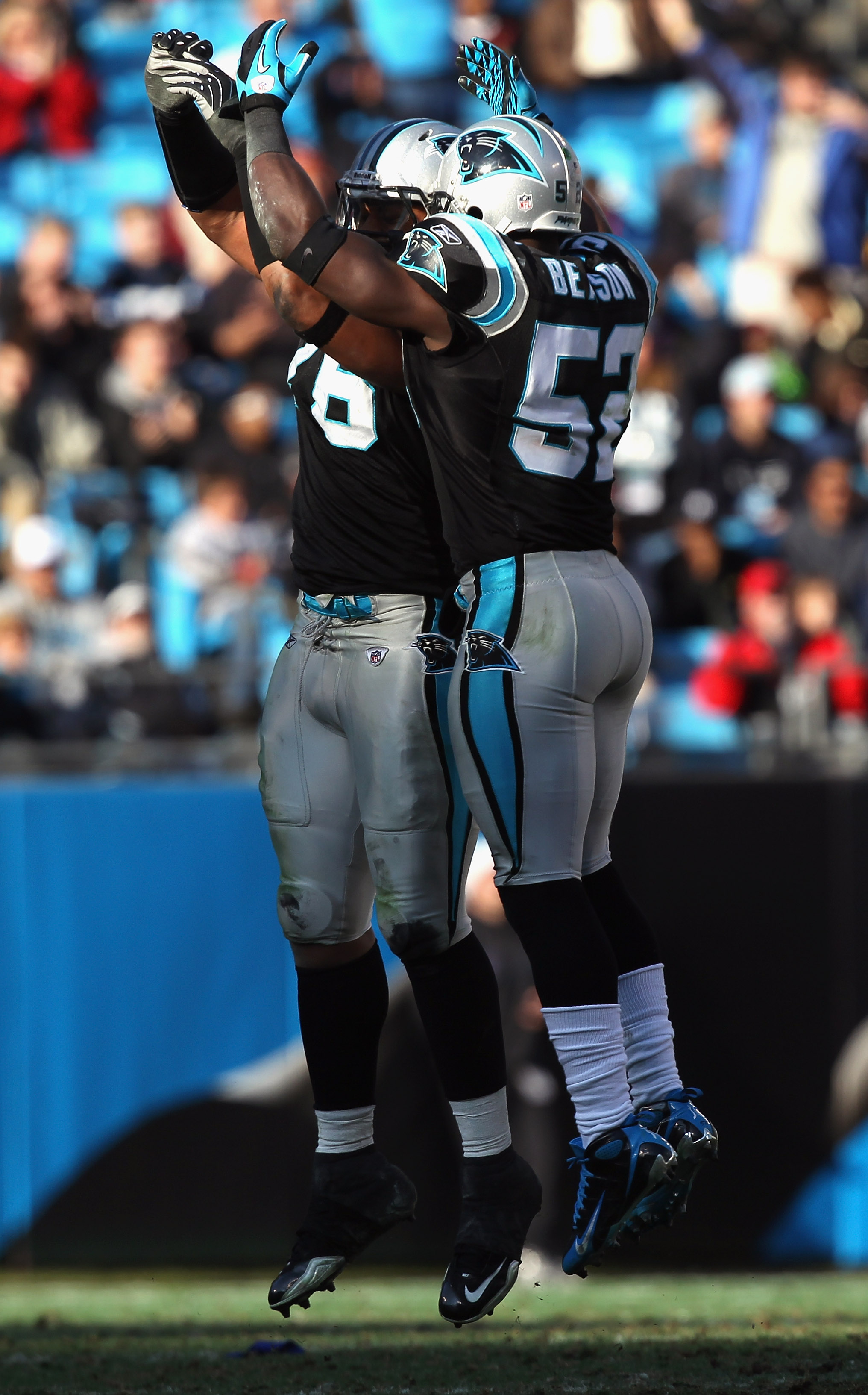 CHARLOTTE, NC - DECEMBER 19:  Teammates Jon Beason #52 and Greg Hardy of the Carolina Panthers celebrate after a defensive stop during their game against the Arizona Cardinals at Bank of America Stadium on December 19, 2010 in Charlotte, North Carolina.