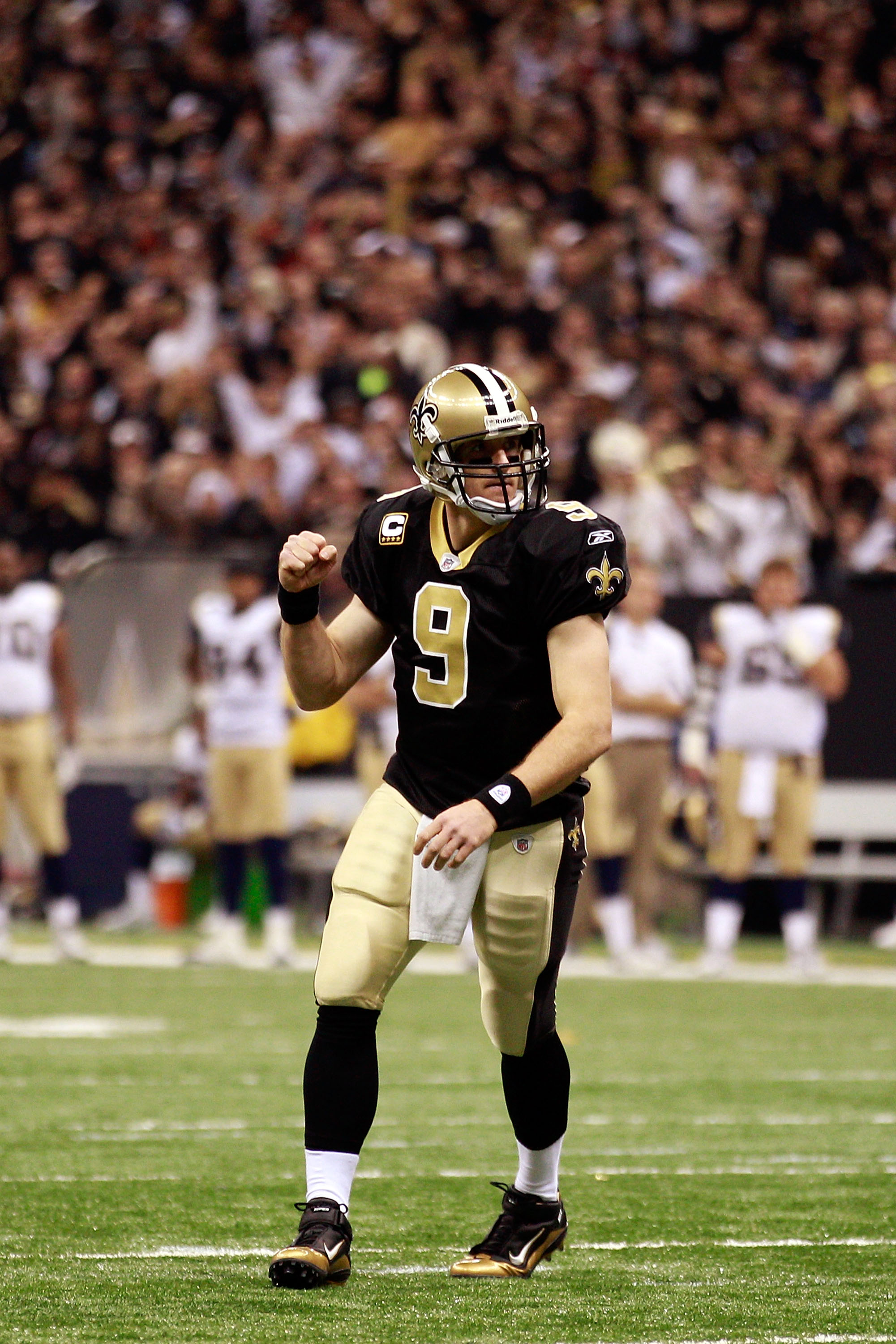 NEW ORLEANS, LA - DECEMBER 12:  Drew Brees #9 of the New Orleans Saints celebrates after scoring a touchdown against the St. Louis Rams at the Louisiana Superdome on December 12, 2010 in New Orleans, Louisiana. The Saints defeated the Rams 31-13.  (Photo
