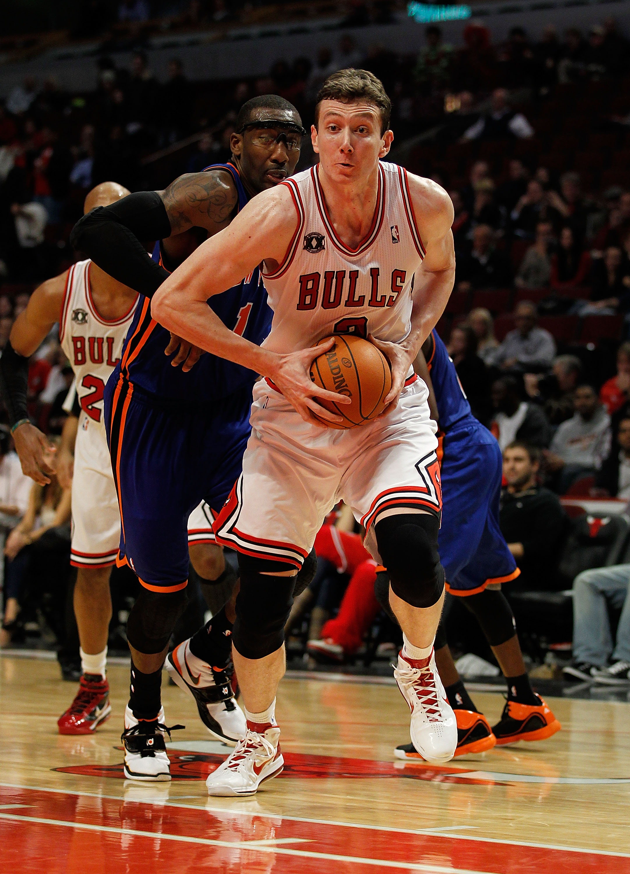 CHICAGO - NOVEMBER 04: Omer Asik #3 of the Chicago Bulls goes up for a dunk past Amar'e Stoudemire #1 of the New York Knicks at the United Center on November 4, 2010 in Chicago, Illinois. The Knicks defeated the Bulls 120-112. NOTE TO USER: User expressly