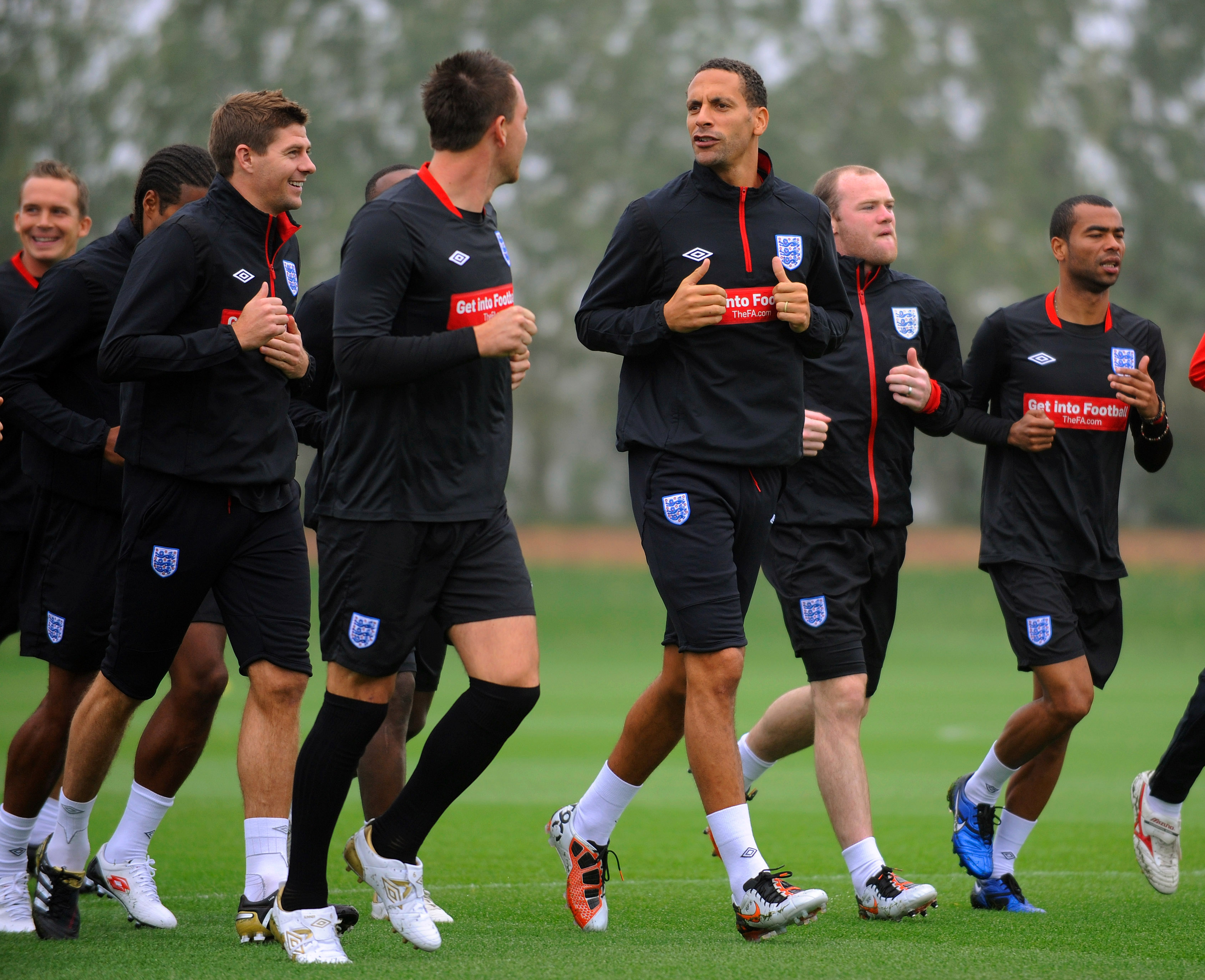 ST ALBANS, ENGLAND - OCTOBER 08:  John Terry, Rio Ferdinand, Steven Gerrard, Wayne Rooney and Ashley Cole warm up during the England training session at London Colney on October 8, 2010 in St Albans, England.  (Photo by Michael Regan/Getty Images)