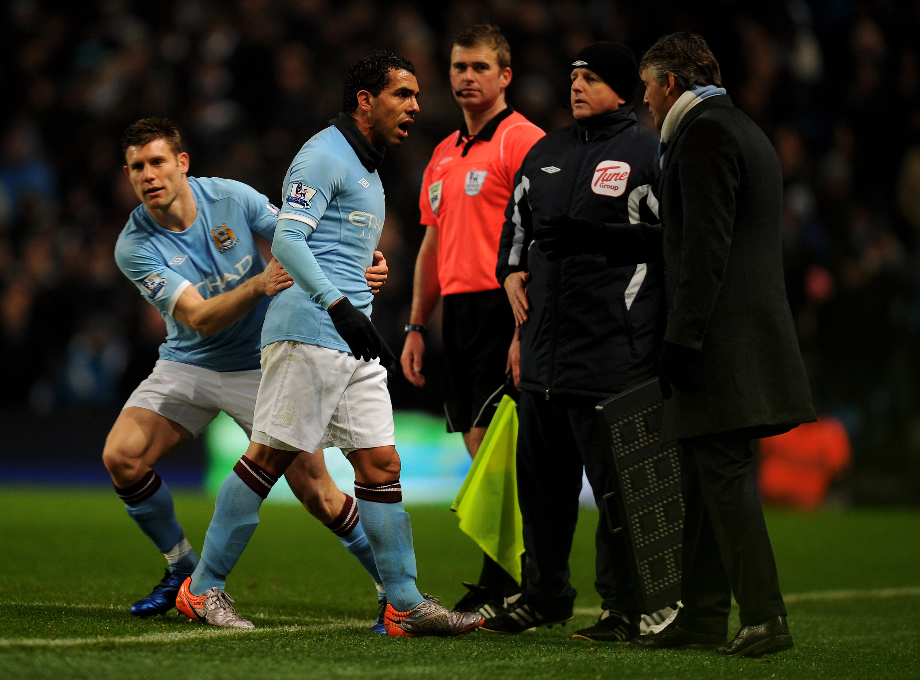 MANCHESTER, UNITED KINGDOM - DECEMBER 04:   Carlos Tevez of Manchester City has words with Manchester City Manager Roberto Mancini after being substituted for team mate James Milner during the Barclays Premier League match between Manchester City and Bolt