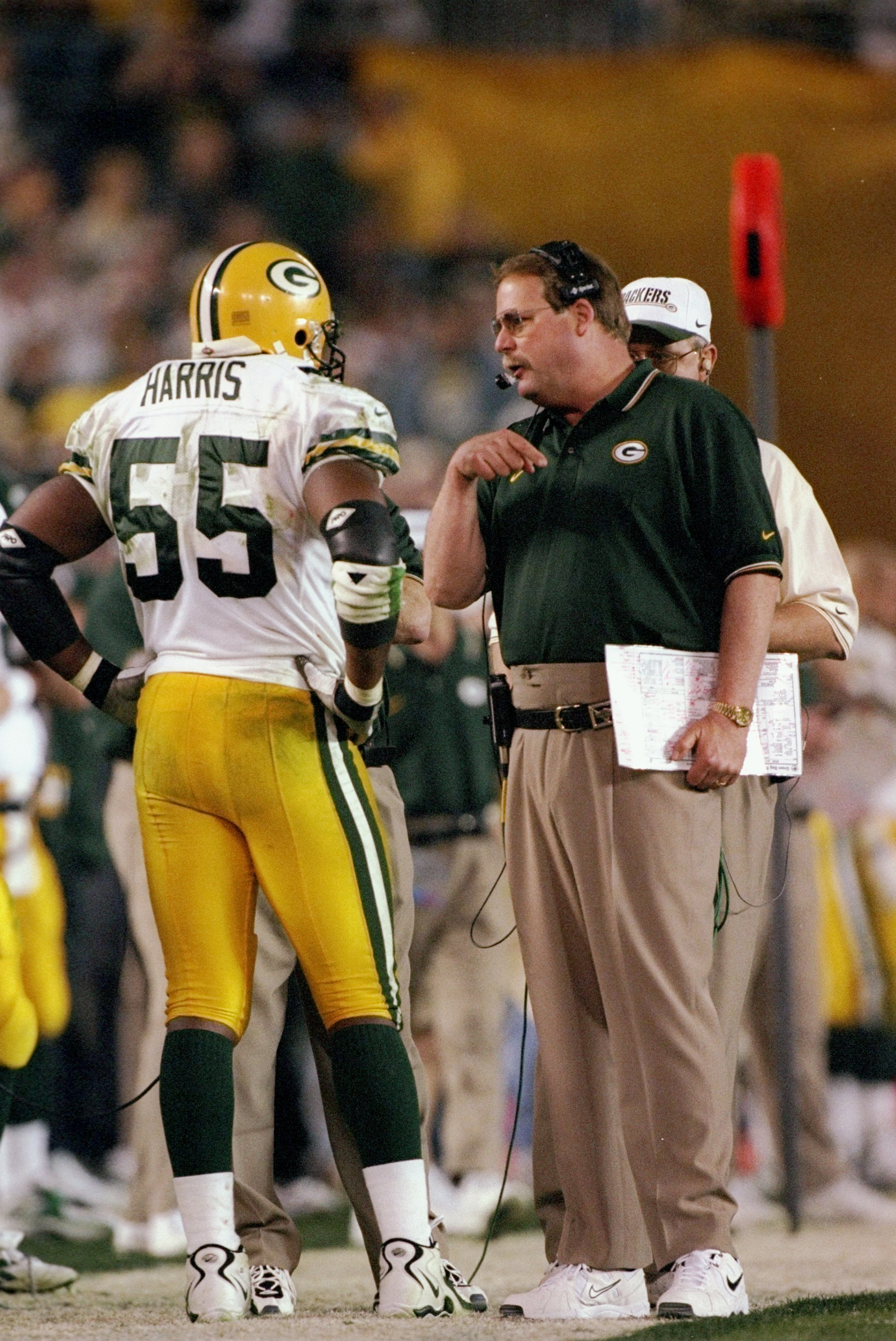 a31ff35378ae 25 Jan 1998  Coach Mike Holmgren of the Green Bay Packers talks to Bernardo  Harris