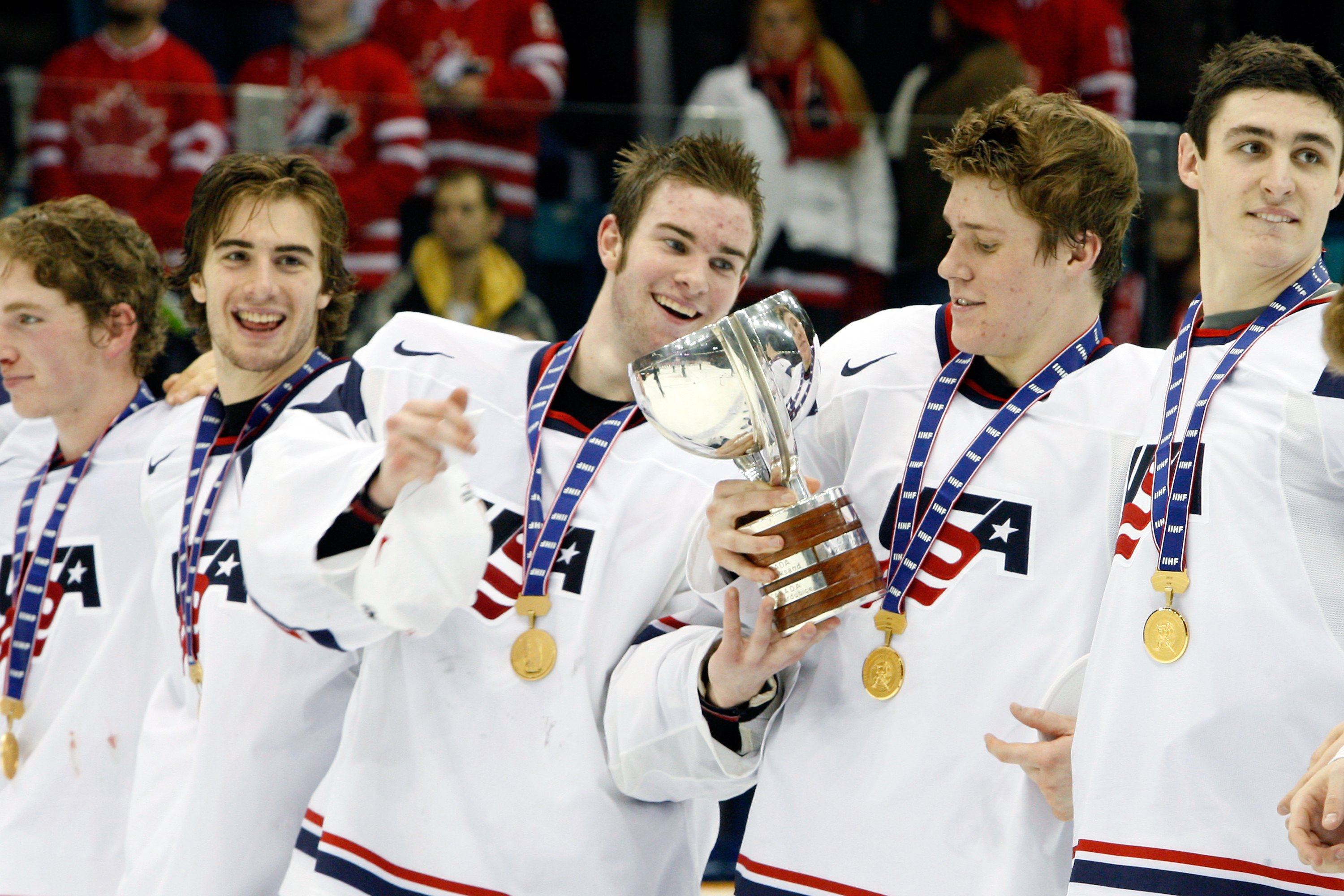 SASKATOON, SK - JANUARY 5:  Jack Campbell #1 of Team USA passes the 2010 IIHF Champions Cup to Jake Gardiner #28 of Team USA during the 2010 IIHF World Junior Championship Tournament Gold Medal game on January 5, 2010 at the Credit Union Centre in Saskato