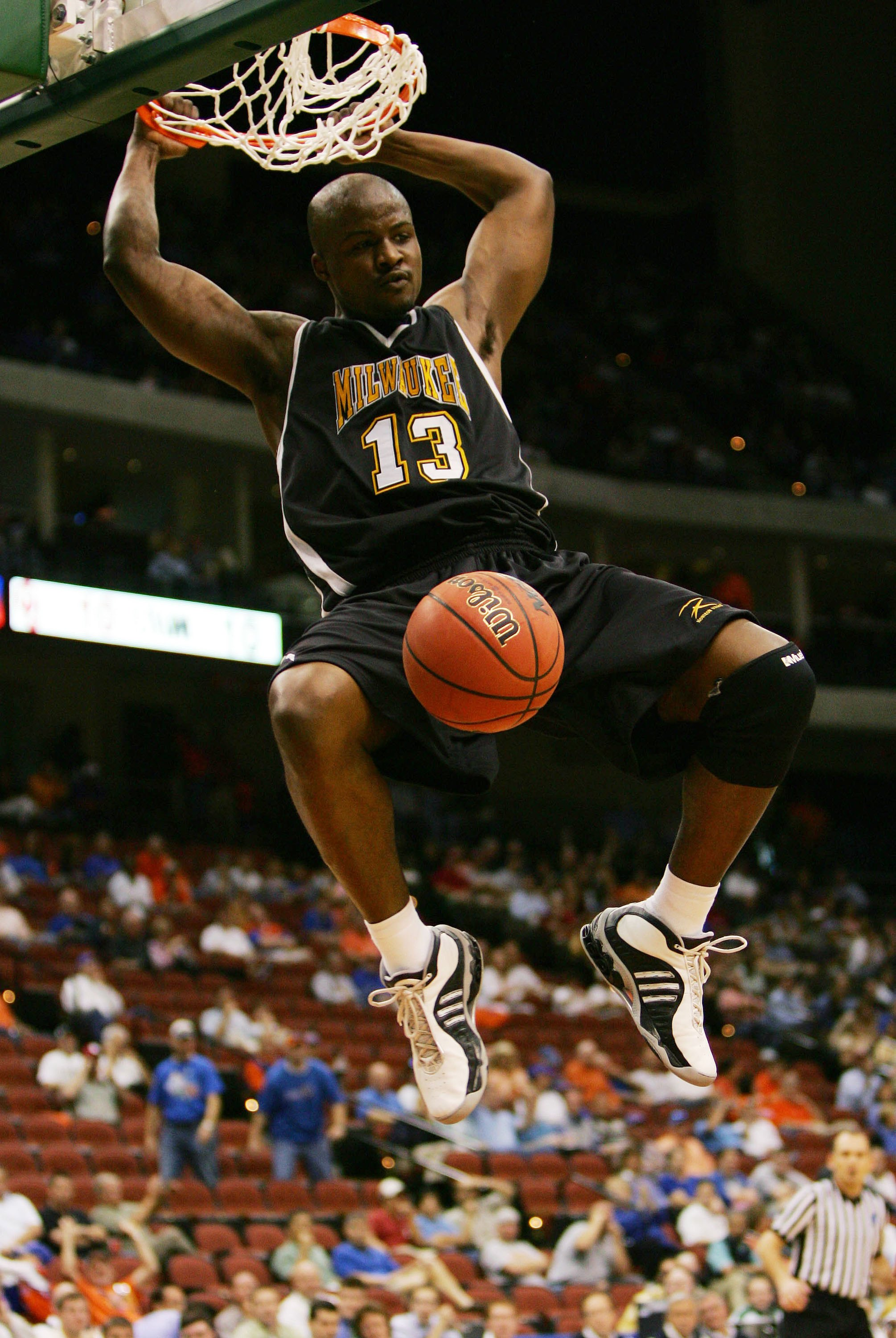 JACKSONVILLE, FL - MARCH 16:  Joah Tucker #13 of the University of Wisconsin-Milwaukee Panthers dunks against the Oklahoma University Sooners during round one of the NCAA National Championship on March 16, 2006 at the Veterans Memorial Arena in Jacksonvil