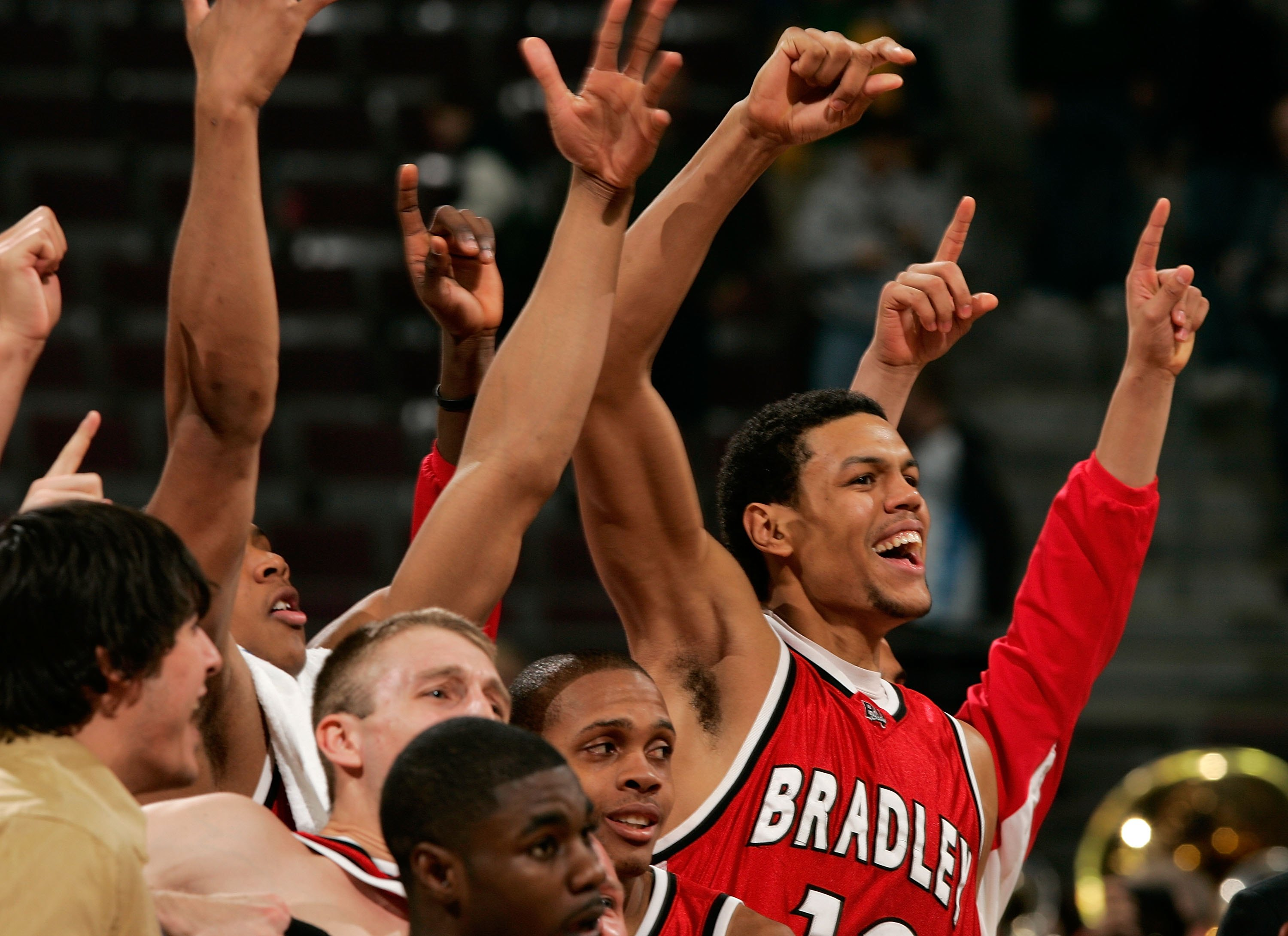AUBURN HILLS, MI - MARCH 17:  Patrick O'Bryant #13 of the Bradley Braves and teammates celebrate the 77-73 upset win over the Kansas Jayhawks during the First Round of the 2006 NCAA Men's Basketball Tournament at The Palace of Auburn Hills on March 17, 20