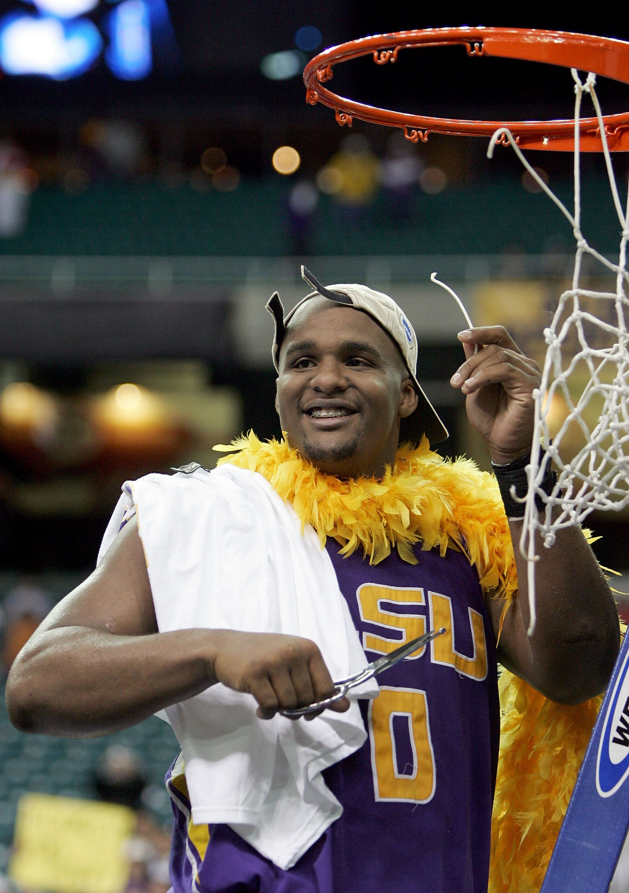 ATLANTA - MARCH 25:  Glen Davis #0 of the LSU Tigers cuts the net after the 70-60 overtime win over the Texas Longhorns during the fourth round game of the 2006 NCAA Division I Men's Basketball Tournament Regional at the Georgia Dome on March 25, 2006 in