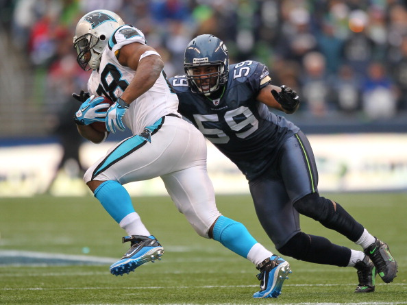 SEATTLE - DECEMBER 05:  Running back Jonathan Stewart #28 of the Carolina Panthers rushes against Aaron Curry #59 of the Seattle Seahawks at Qwest Field on December 5, 2010 in Seattle, Washington. The Seahawks won, 31-14. (Photo by Otto Greule Jr/Getty Im
