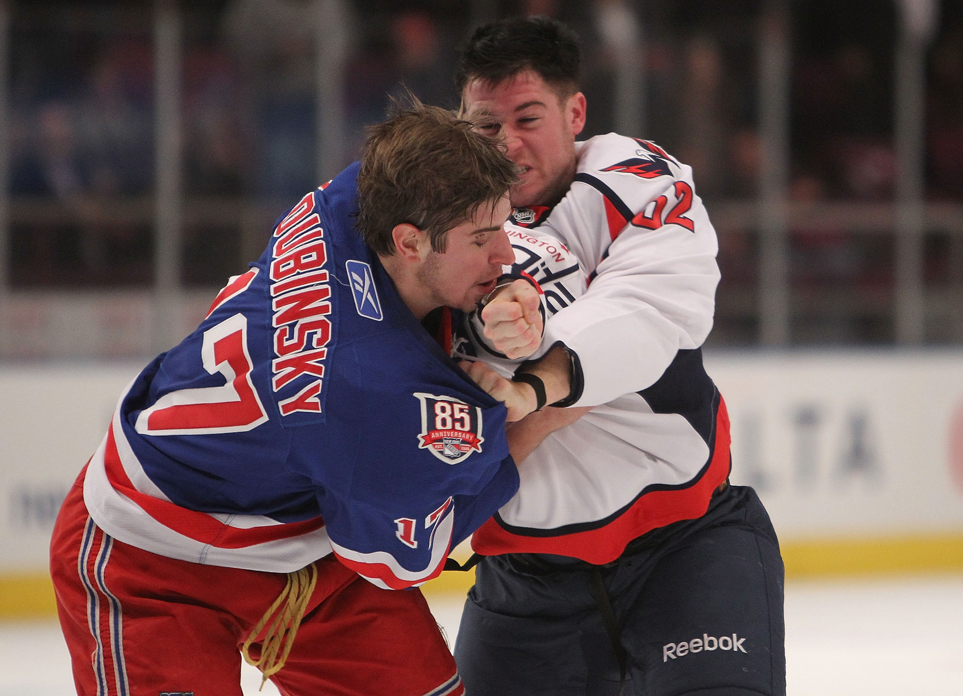 NEW YORK - NOVEMBER 09: Brandon Dubinsky #17 of the New York Rangers fights with Mike Green #52 of the Washington Capitals at Madison Square Garden on November 9, 2010 in New York City.  (Photo by Nick Laham/Getty Images)