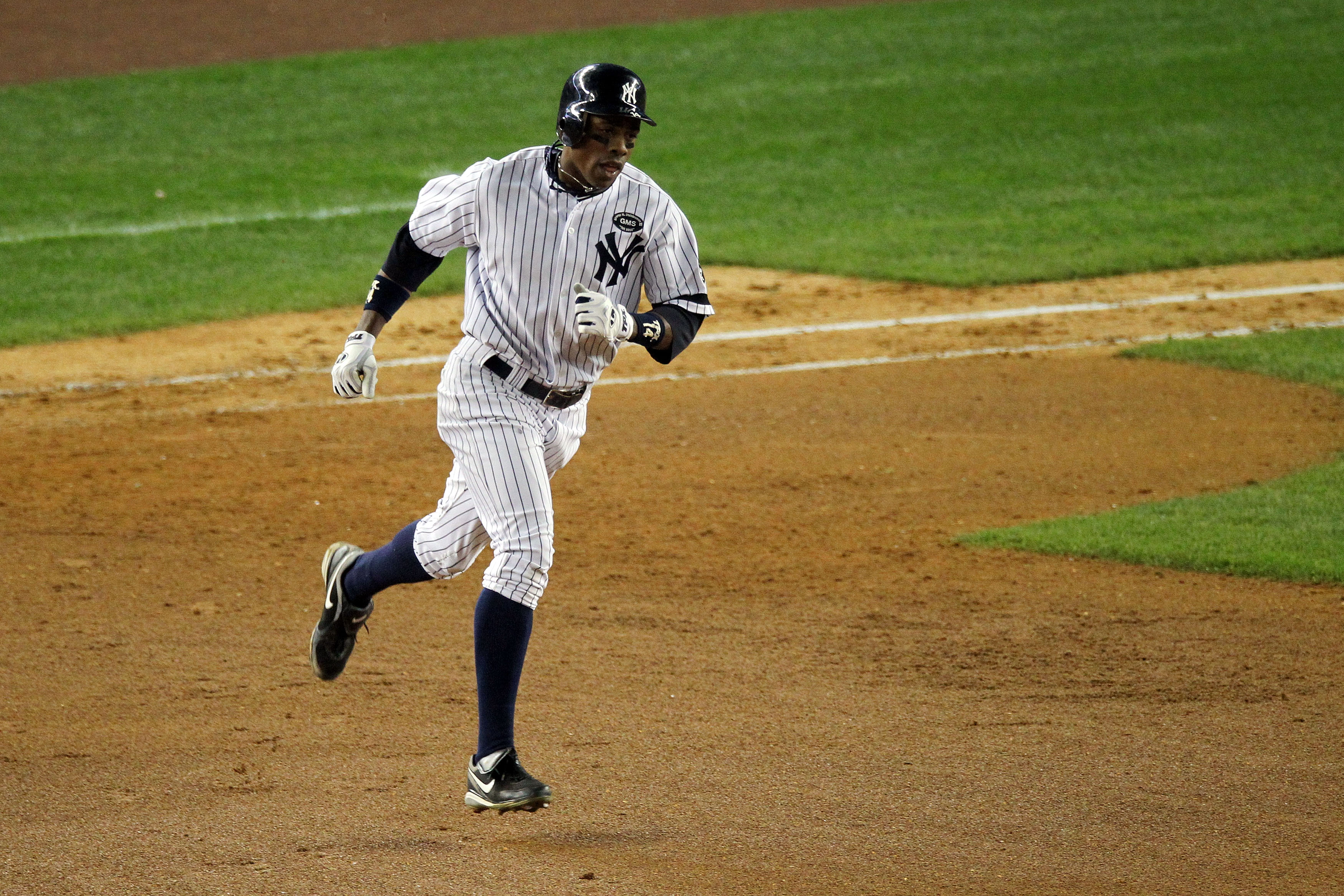 NEW YORK - OCTOBER 20:  Curtis Granderson #14 of the New York Yankees runs the bases on his solo home run in the bottom of the eighth inning against the Texas Rangers in Game Five of the ALCS during the 2010 MLB Playoffs at Yankee Stadium on October 20, 2