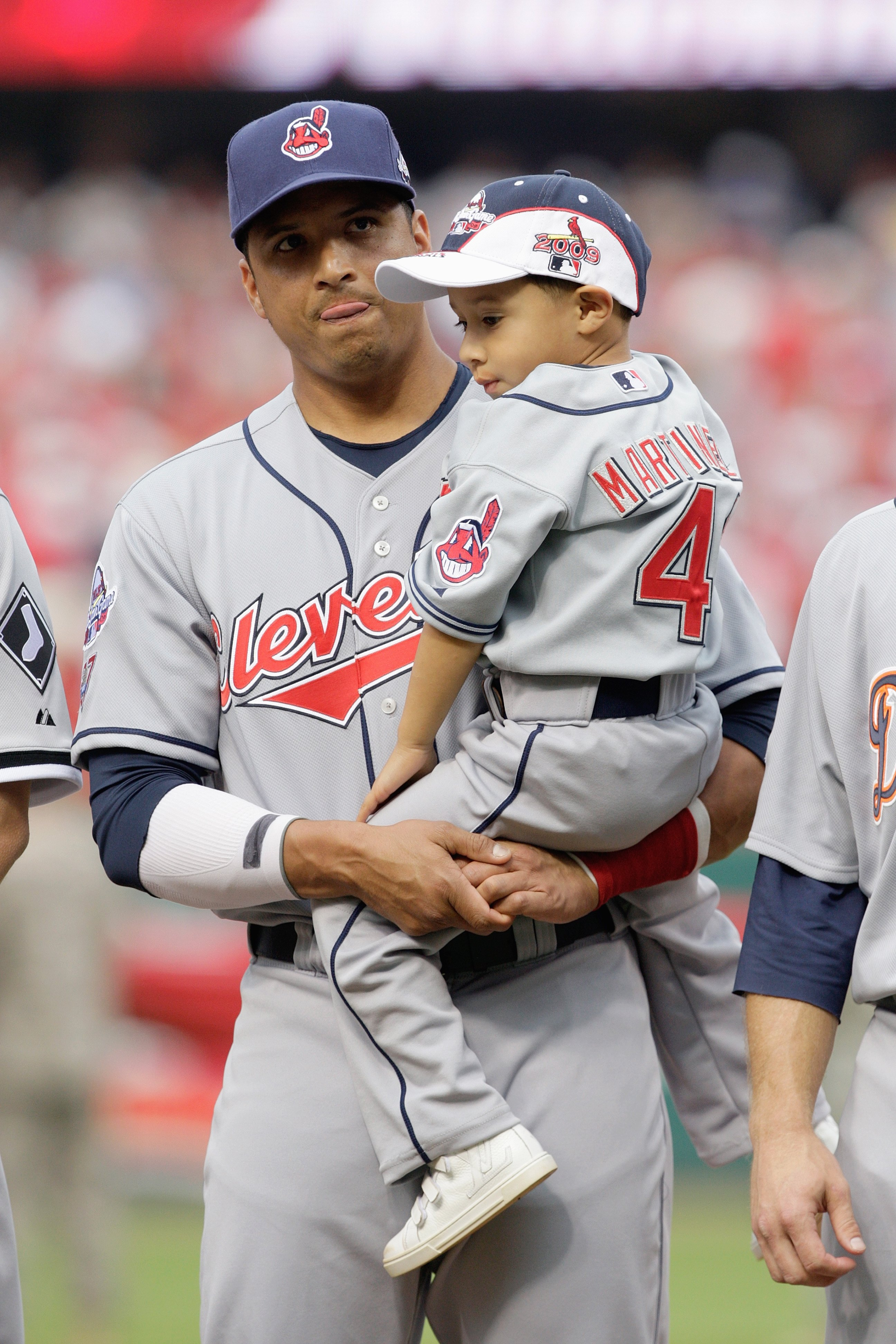 ST. LOUIS, MO - JULY 14: American League All-Star Victor Martinez of Cleveland Indians stands with his son during the lineup before the 2009 MLB All-Star Game at Busch Stadium on July 14, 2009 in St Louis, Missouri. (Photo by Pool/Getty Images)