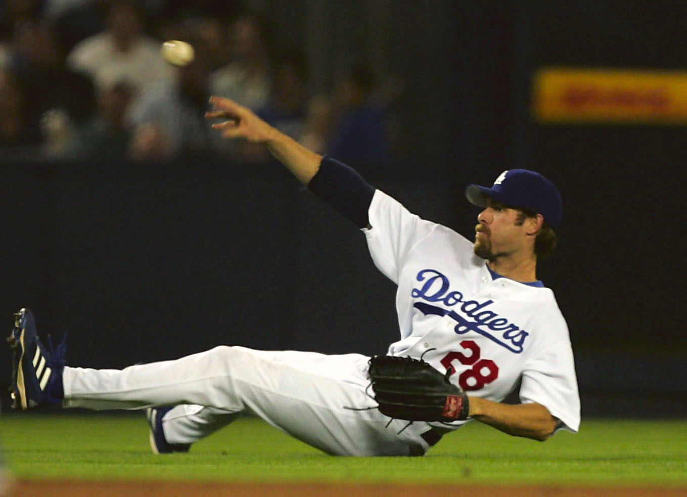 LOS ANGELES - SEPTEMBER 29:  Left fielder Jayson Werth #28 of the Los Angeles Dodgers throws to third but can't get Luis Gonzalez of the Arizona Diamondbacks after diving for a single by Chad Tracy on September 29, 2005 at Dodger Stadium in Los Angeles, C